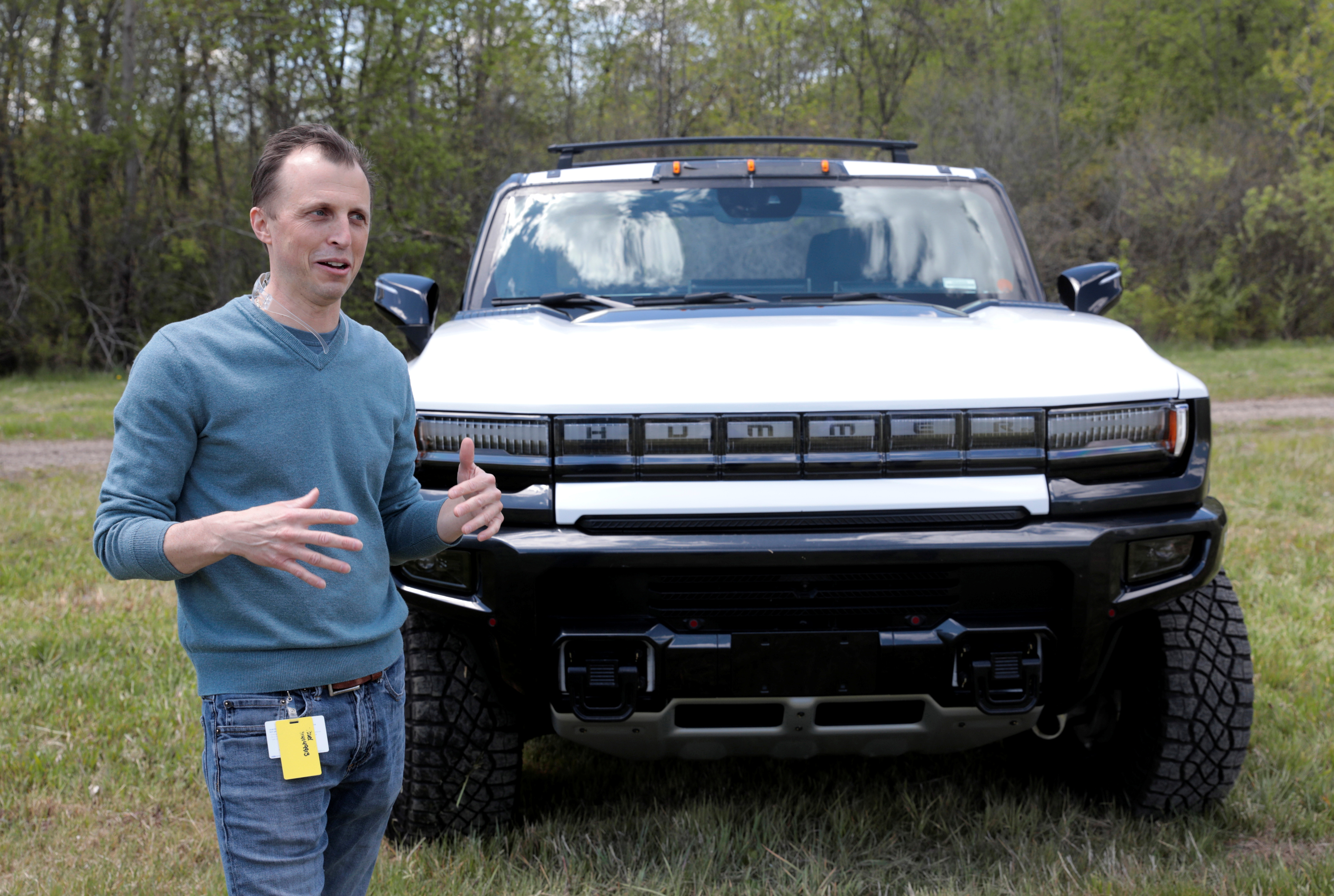 Josh Tavel, executive engineer for GMC Hummer EV, talks about a pre-production version of the Hummer electric pickup in Milford, Michigan, U.S., May 14, 2021.  Photo taken May 14, 2021.   REUTERS/Rebecca Cook