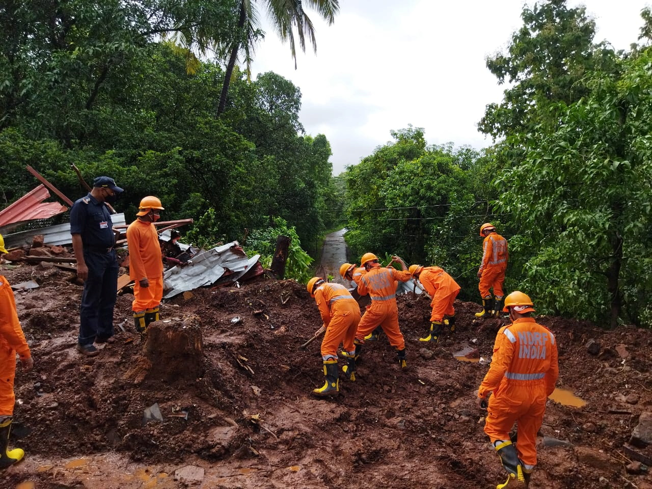 Members of National Disaster Response Force (NDRF) conduct a search and rescue operation after a landslide following heavy rains in Ratnagiri district, Maharashtra state, India, July 25, 2021. National Disaster Response Force/Handout via REUTERS