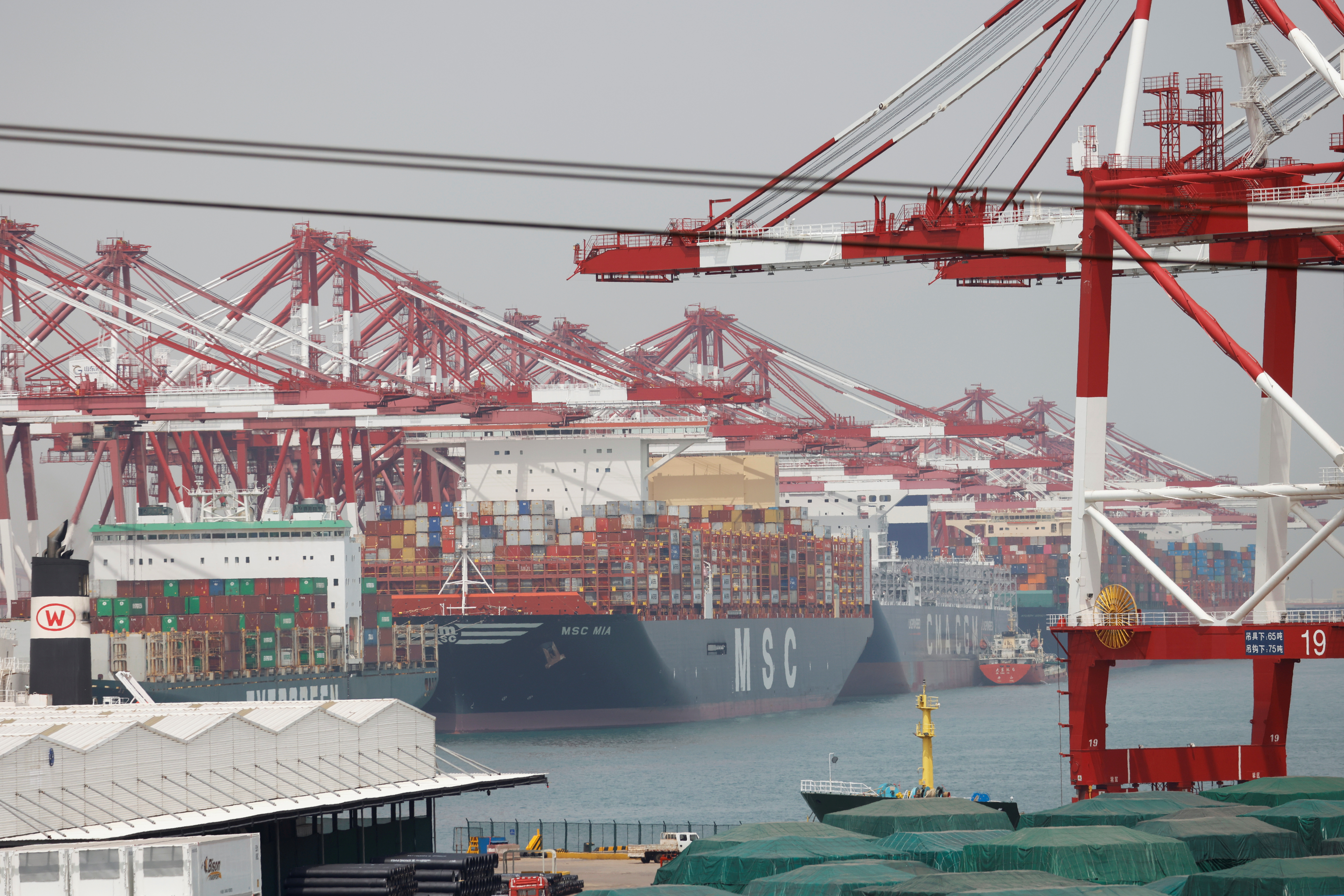 Container ships are seen at Qingdao port in Shandong province, China,  April 28, 2021. REUTERS/Carlos Garcia Rawlins/File Photo