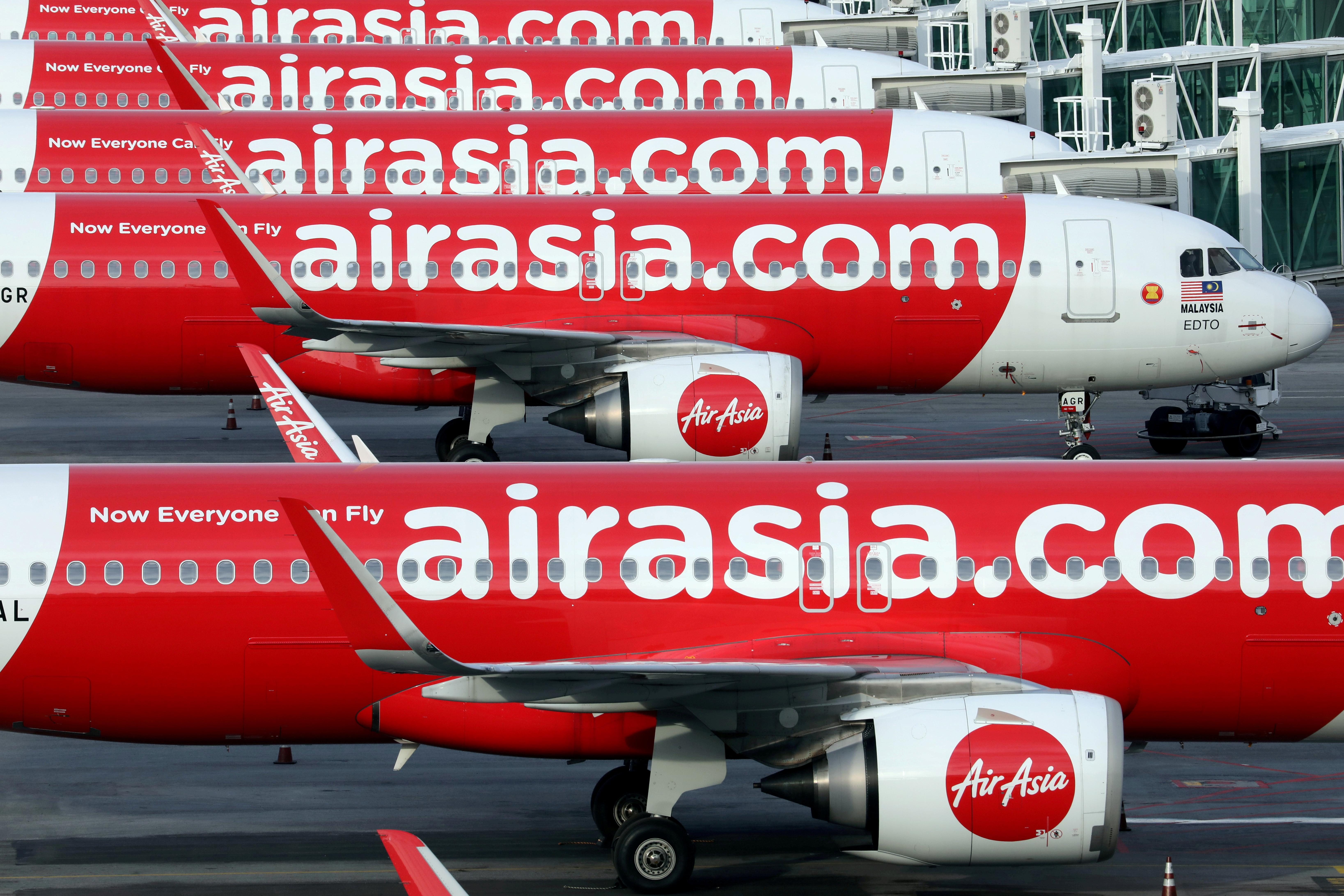 Airasia planes are seen parked at Kuala Lumpur International Airport 2, amid the coronavirus disease (COVID-19) outbreak in Sepang, Malaysia October 6, 2020. REUTERS/Lim Huey Teng/File Photo