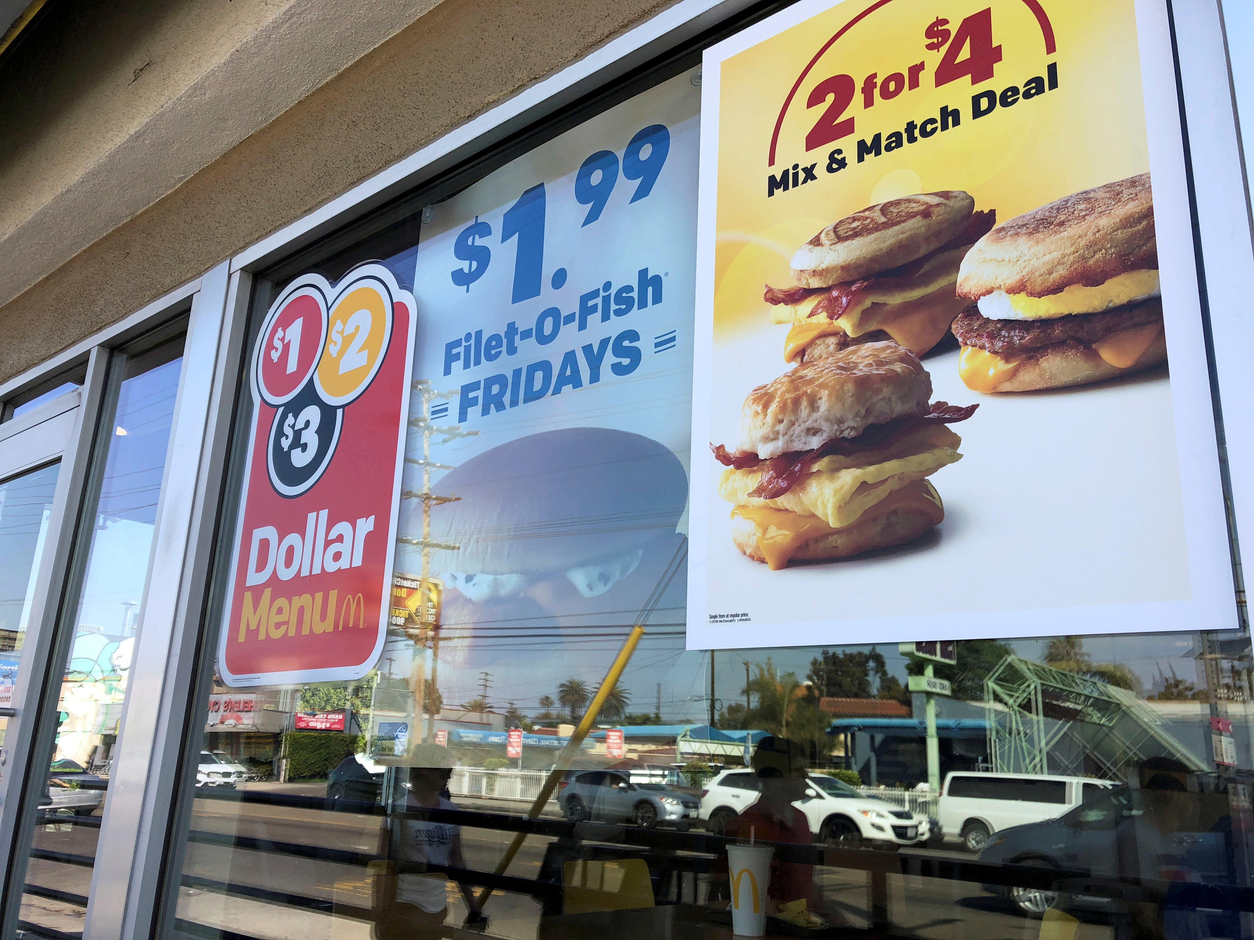 Dollar Menu advertisements are seen outside a McDonald's restaurant in Venice, California, April 29, 2018. REUTERS/Lisa Baertlein