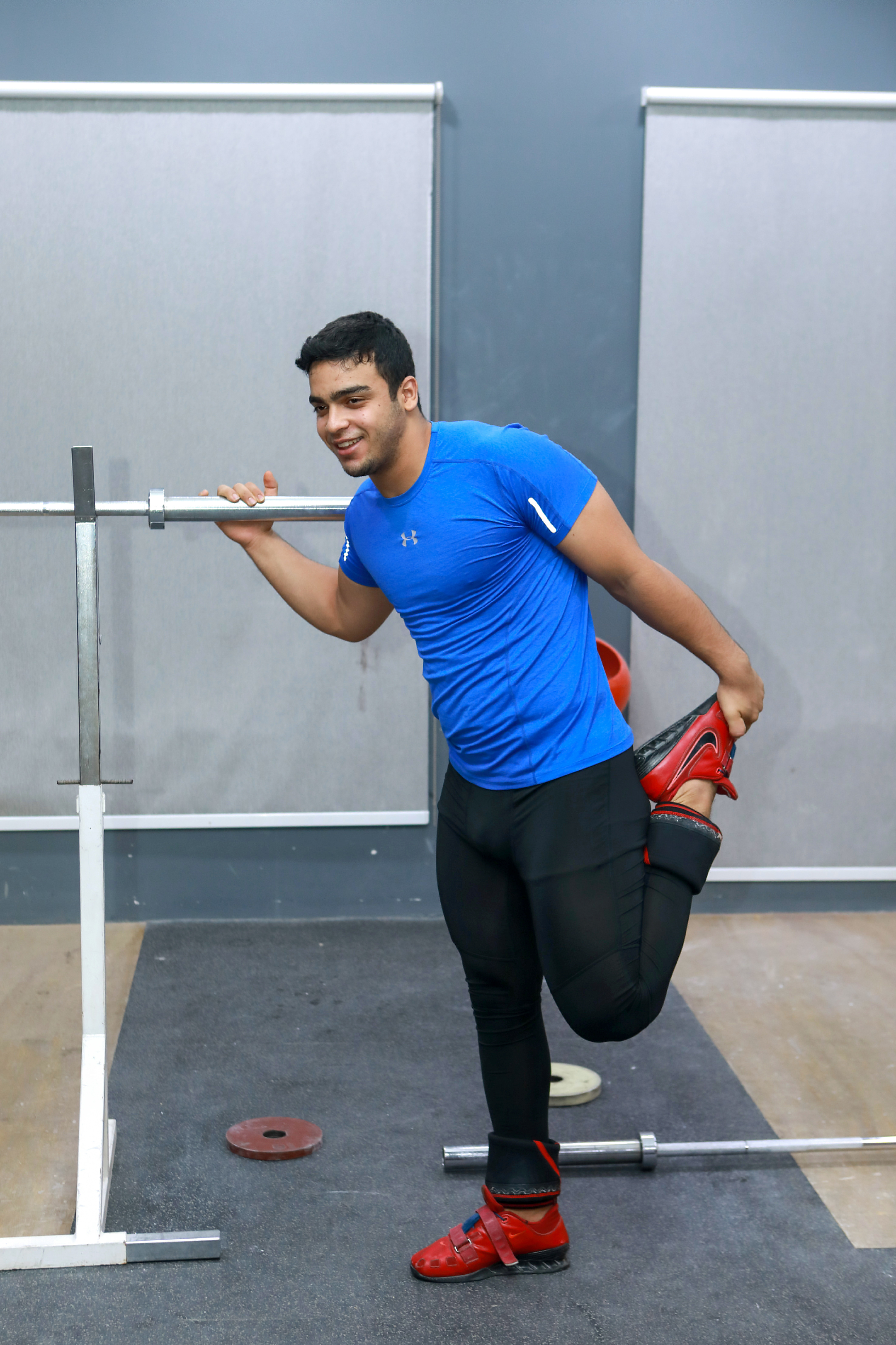 Gaza weight-lifter Mohammad Hamada who is the first Palestinian to compete in the game at the Olympics when it kicks off in Tokyo, practices at a gym in Doha, Qatar July 18, 2021. REUTERS/Rami Barbour
