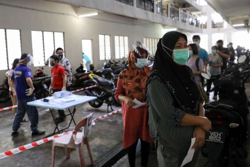 People wait in line to be tested for the coronavirus, amid the spread of COVID-19, in Seri Kembangan, Malaysia, July 12, 2021. REUTERS/Lim Huey Teng