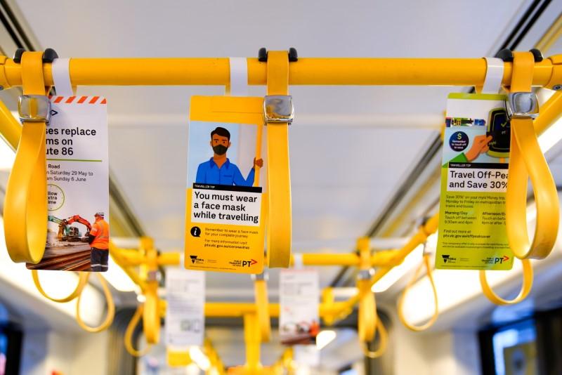 A sign regarding mandatory mask wearing is seen on a tram in Melbourne, Australia, May 28, 2021.  REUTERS/Sandra Sanders/File Photo