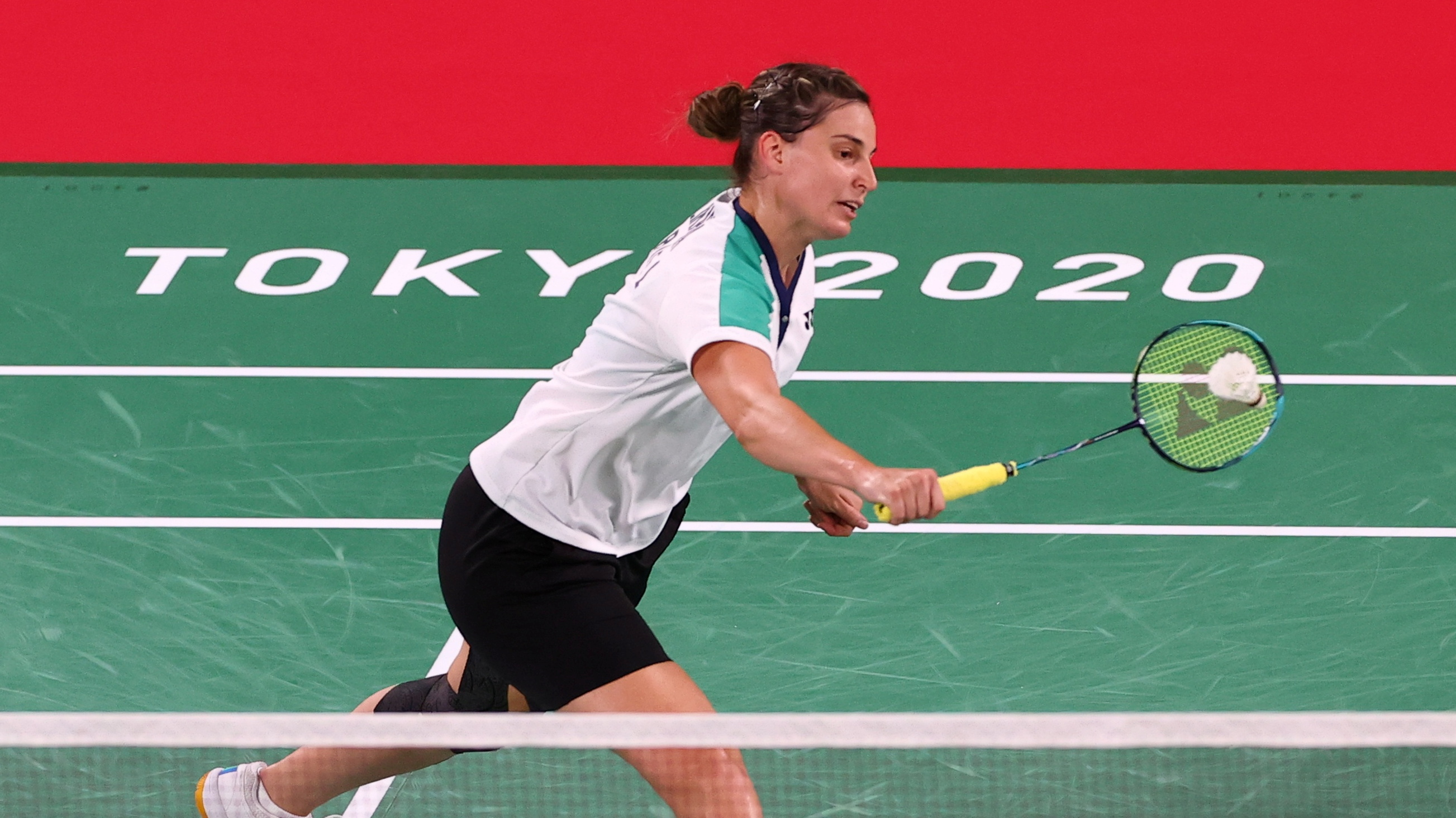 Tokyo 2020 Olympics - Badminton - Women's Singles - Group Stage - MFS - Musashino Forest Sport Plaza, Tokyo, Japan – July 25, 2021. Ksenia Polikarpova of Israel in action during the match against P.V. Sindhu of India. REUTERS/Leonhard Foeger
