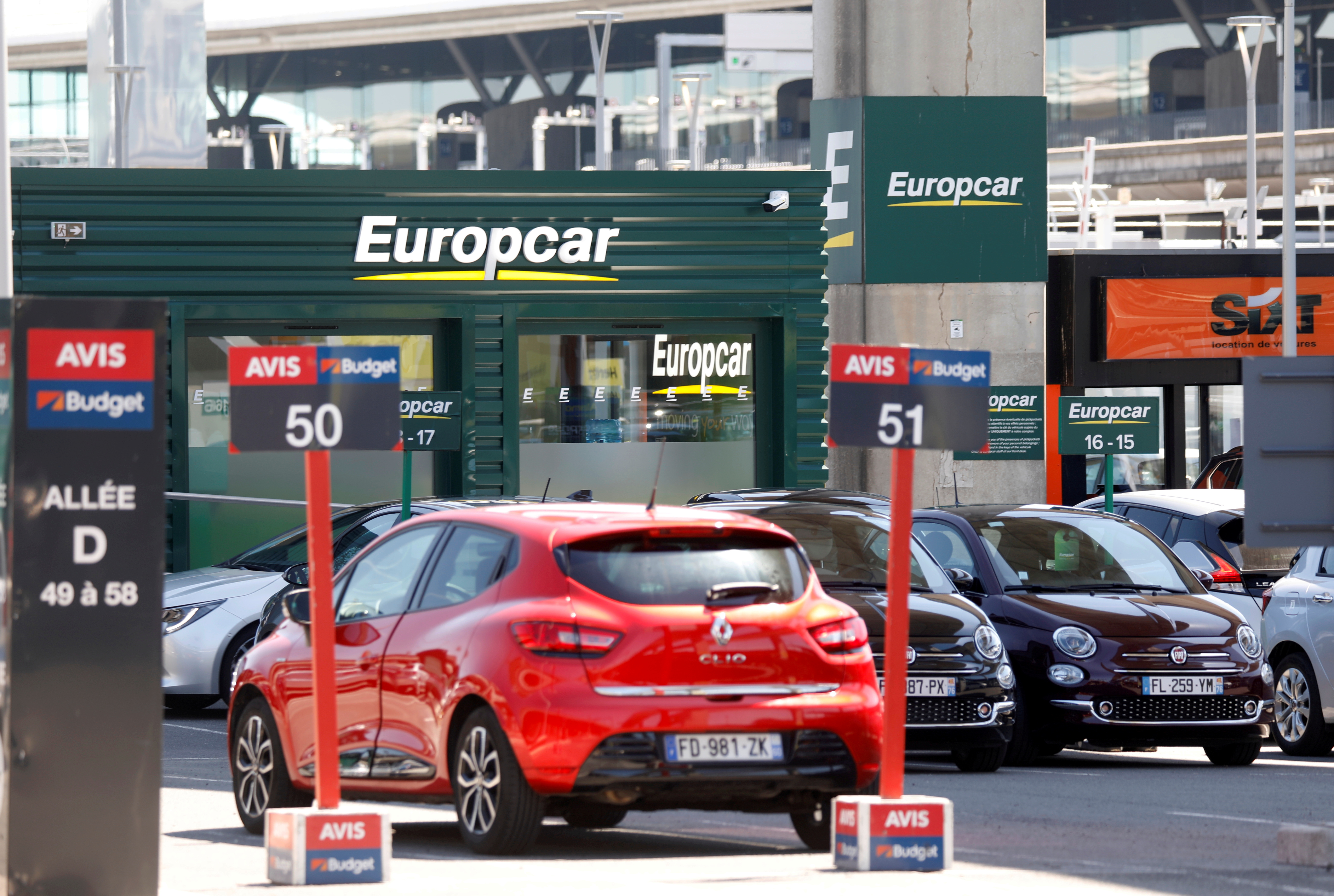 Cars are seen at car rental companies Avis and Europcar outside Paris Charles de Gaulle airport in Roissy-en-France during the outbreak of the coronavirus disease (COVID-19) in France May 19, 2020. REUTERS/Charles Platiau/File Photo