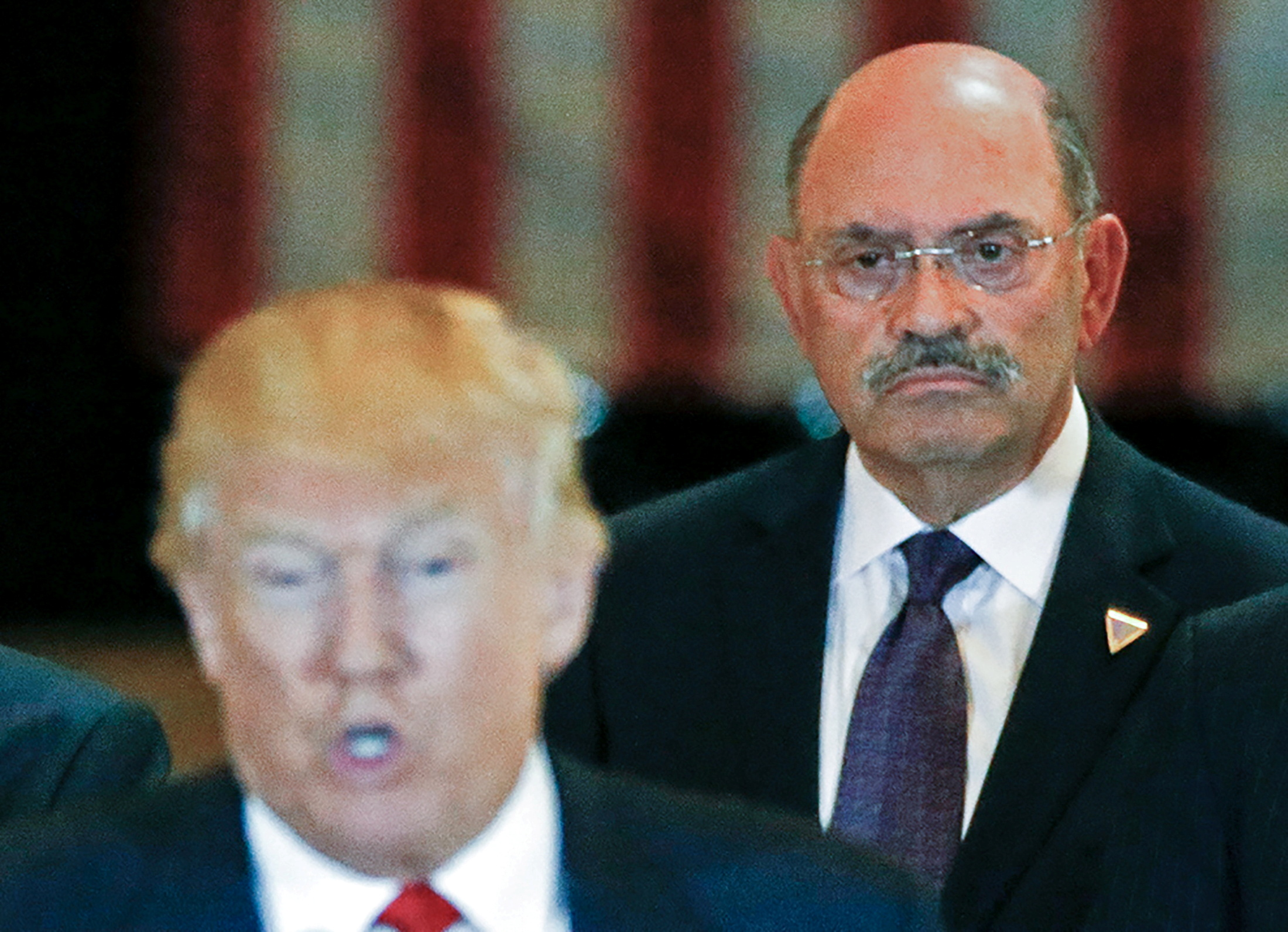 Trump Organization chief financial officer Allen Weisselberg looks on as then-U.S. Republican presidential candidate Donald Trump speaks during a news conference at Trump Tower in Manhattan, New York, U.S., May 31, 2016. REUTERS/Carlo Allegri/File Photo