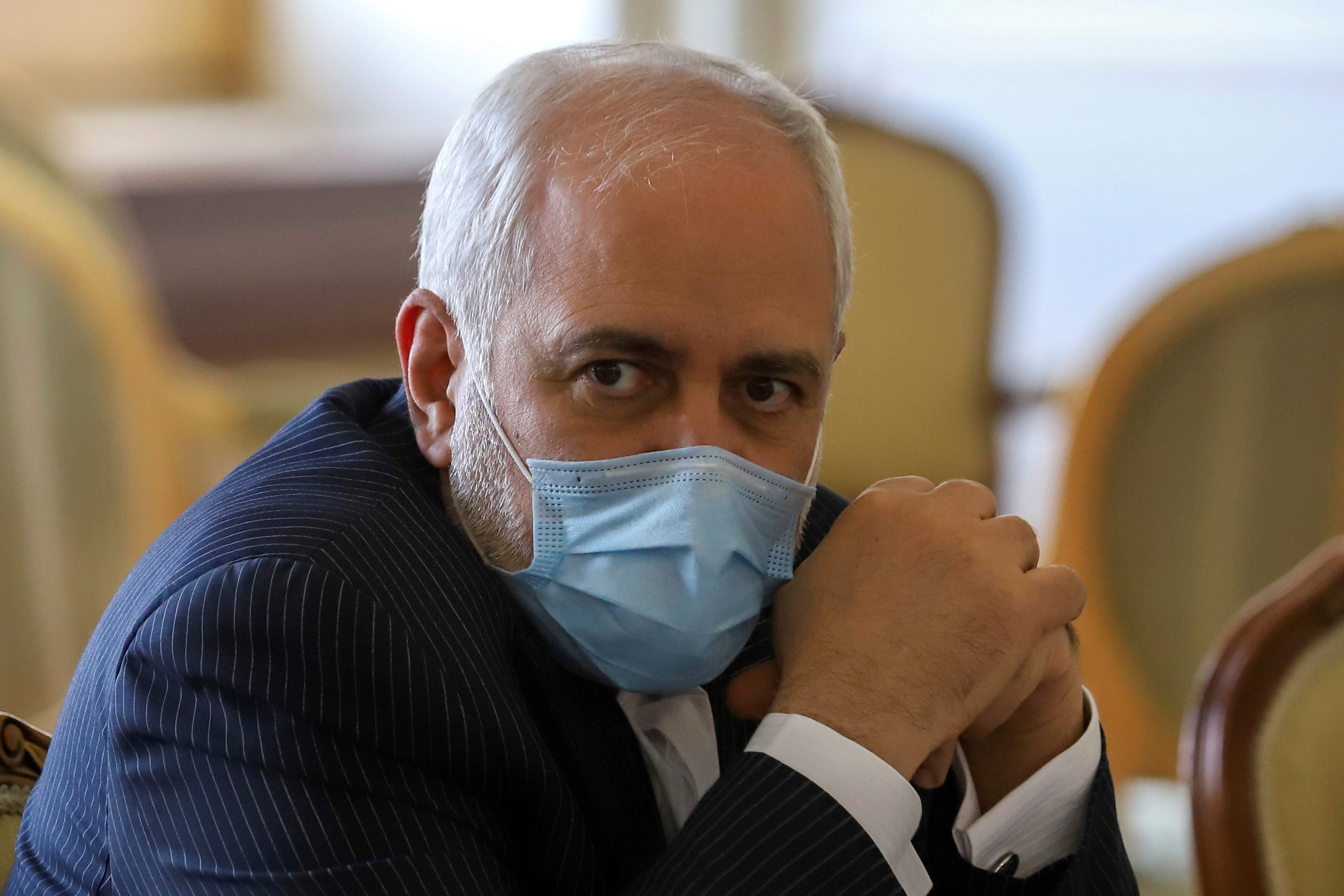 Iran's Foreign Minister Mohammad Javad Zarif looks on during a meeting with International Atomic Energy Agency (IAEA) Director General Rafael Grossi in Tehran, Iran February 21, 2021. Majid Asgaripour/WANA (West Asia News Agency) via REUTERS