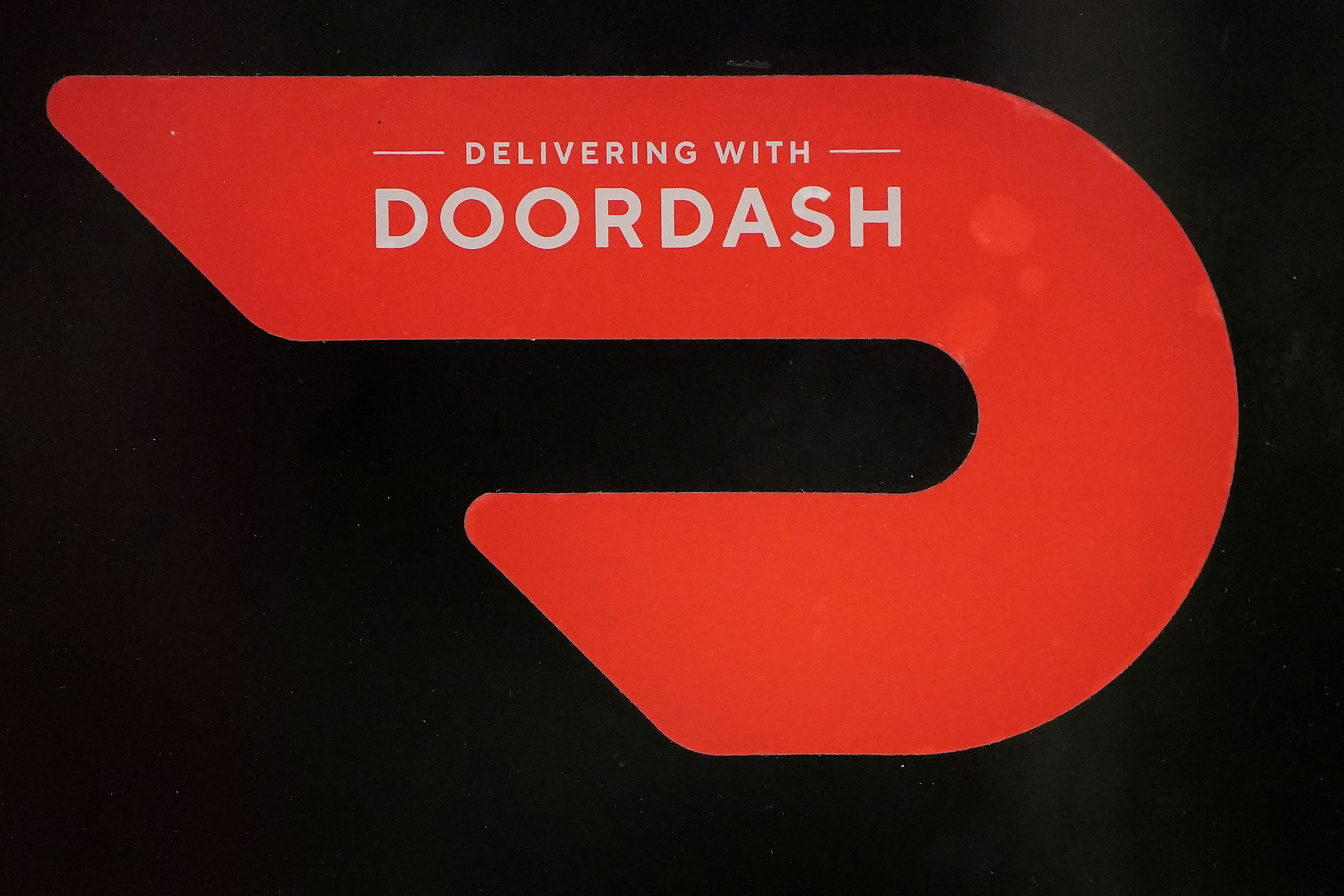 A DoorDash sign is pictured on a restaurant in the Manhattan borough of New York City, New York, U.S., December 9, 2020. REUTERS/Carlo Allegri/File Photo