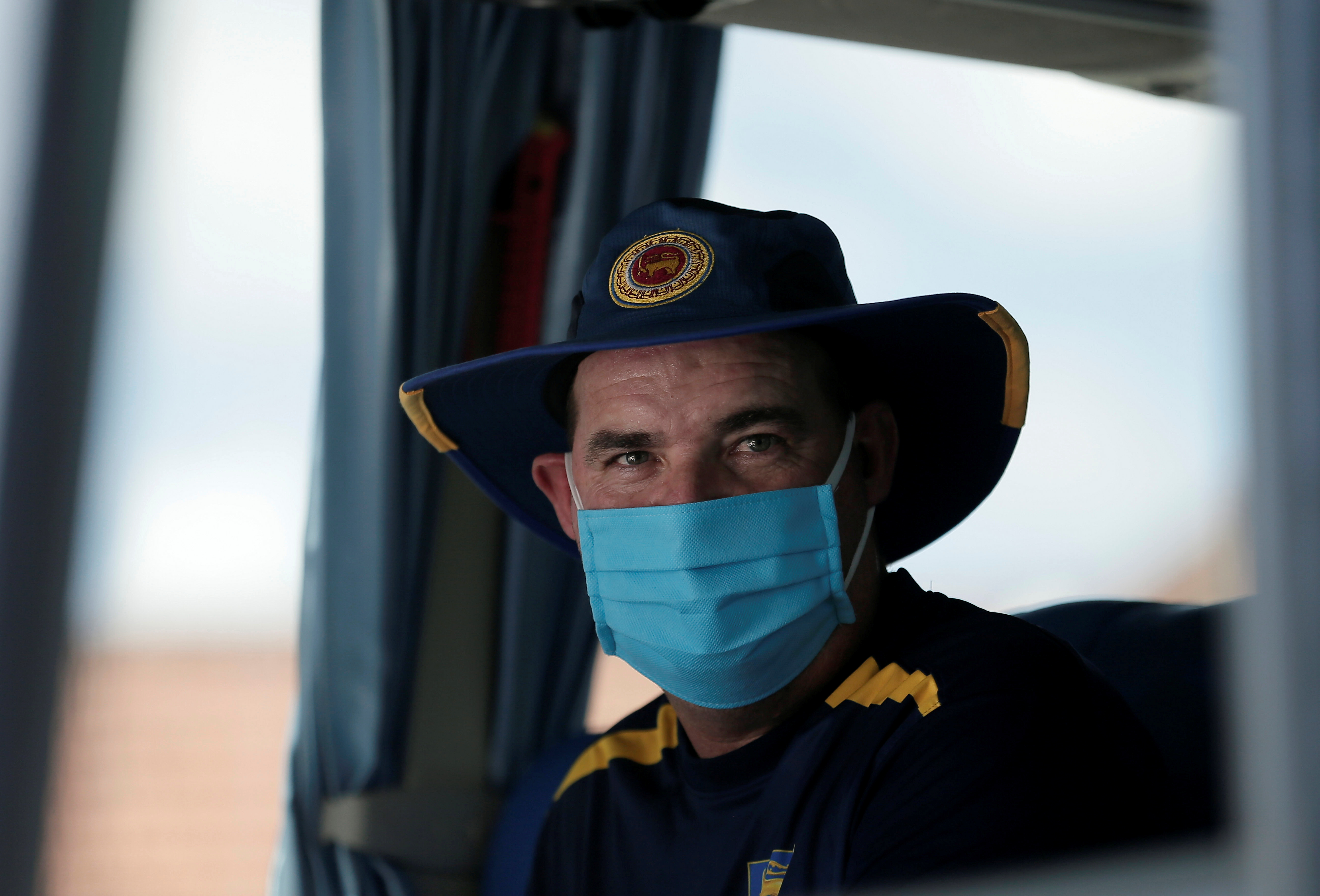Sri Lankan national cricket team coach Mickey Arthur wearing a protective mask looks on from inside the team bus after their first practice session after almost two months lockdown amidst concerns about the spread of coronavirus disease (COVID-19), in Colombo, Sri Lanka, June 2, 2020. REUTERS/Dinuka Liyanawatte/File Photo
