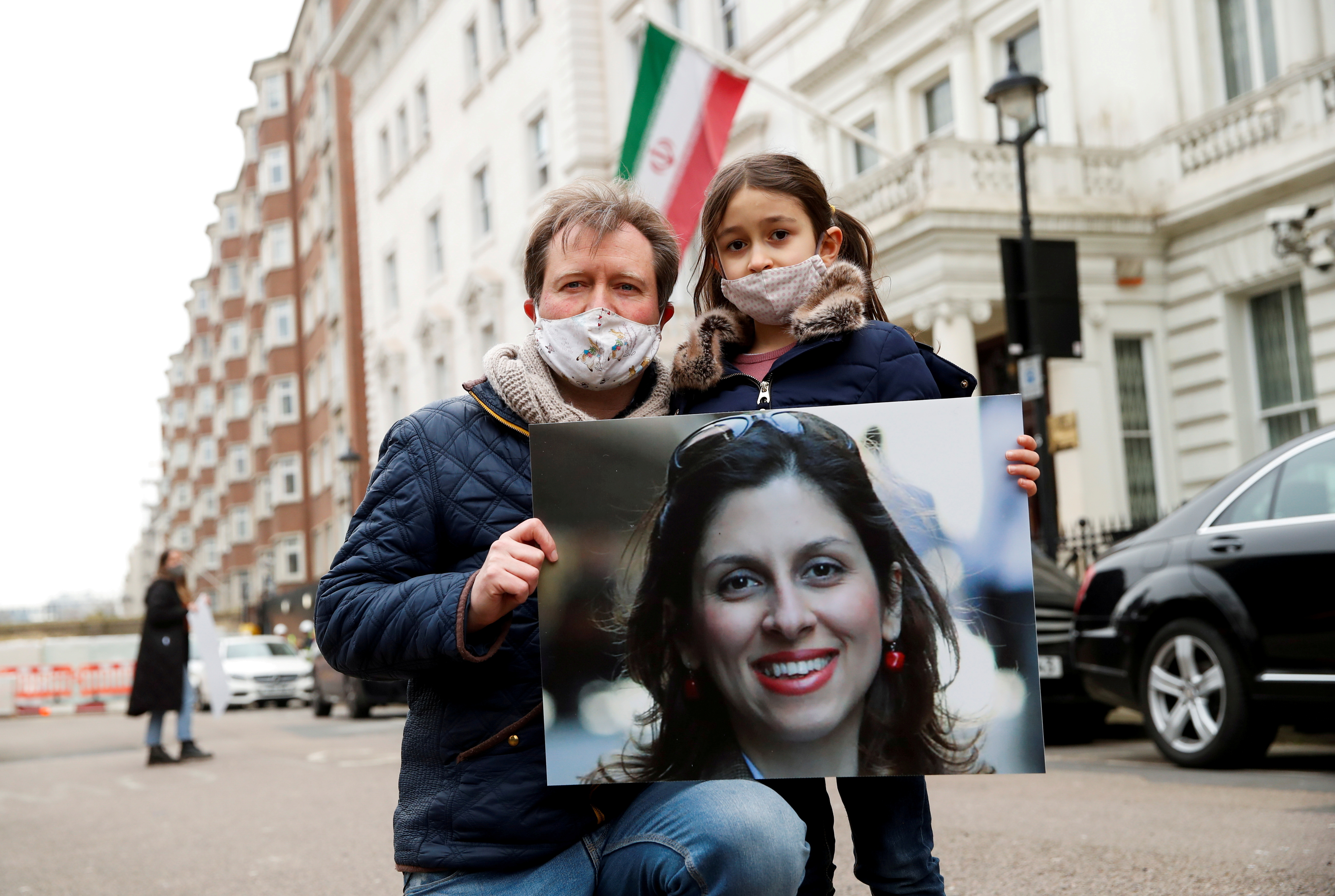 Richard Ratcliffe, husband of British-Iranian aid worker Nazanin Zaghari-Ratcliffe, and their daughter Gabriella protest outside the Iranian Embassy in London, Britain March 8, 2021. REUTERS/Andrew Boyers/File Photo