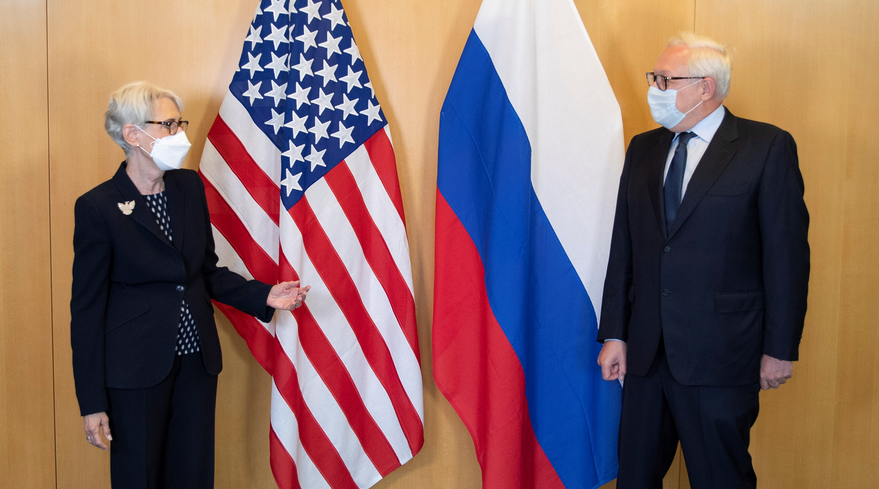 U.S. Deputy Secretary of State Wendy Sherman (L) and Russian Deputy Foreign Minister Sergei Ryabkov pose in front of their national flags before a meeting at the U.S. diplomatic mission in Geneva, Switzerland July 28, 2021. U.S. Mission Geneva/Handout via REUTERS