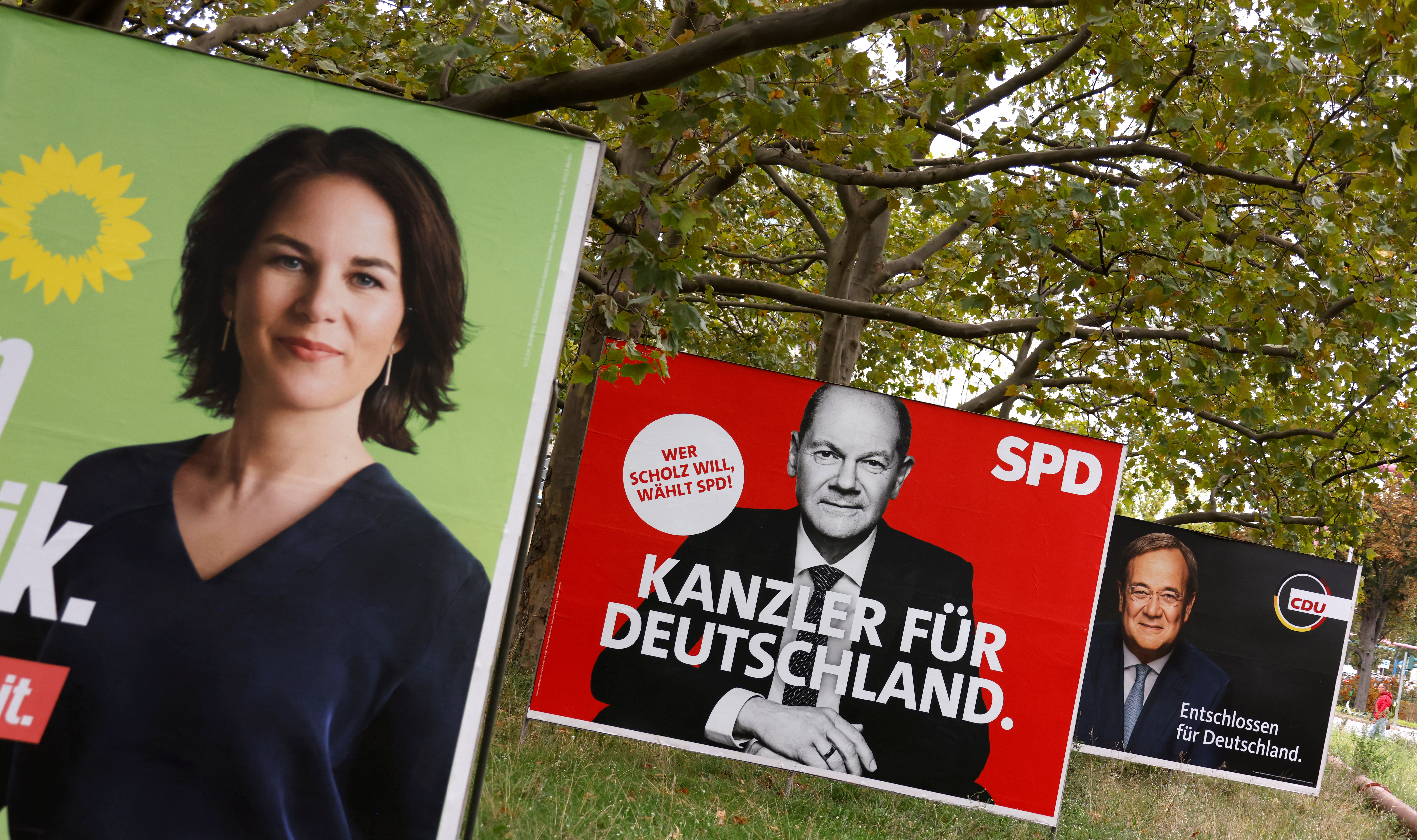 Election posters of Germany's top candidates for chancellor Annalena Baerbock, co-leader of Germany's Green party, Olaf Scholz, German Minister of Finance of the Social Democratic Party (SPD) and Armin Laschet, North Rhine-Westphalia's State Premier and Christian Democratic Union (CDU) leader, are pictured, in Berlin, Germany, September 16, 2021.   REUTERS/Fabrizio Bensch