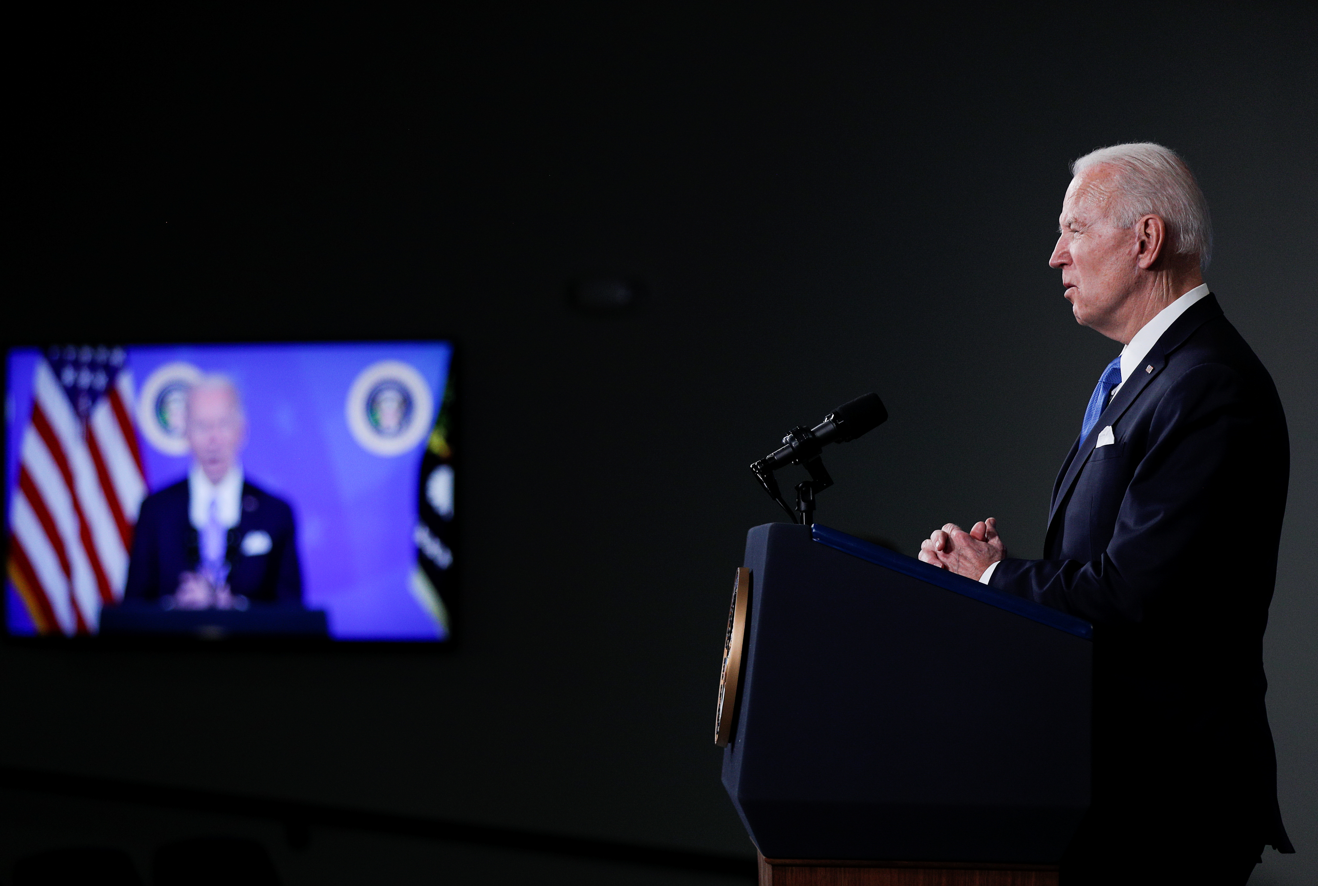 U.S. President Joe Biden announces administration plans to double its order of the single-shot Johnson & Johnson coronavirus vaccine, procuring an additional 100 million doses, during an event with Johnson & Johnson CEO Alex Gorsky and Merck CEO Kenneth Frazier in the South Court Auditorium at the White House in Washington, U.S., March 10, 2021. REUTERS/Tom Brenner