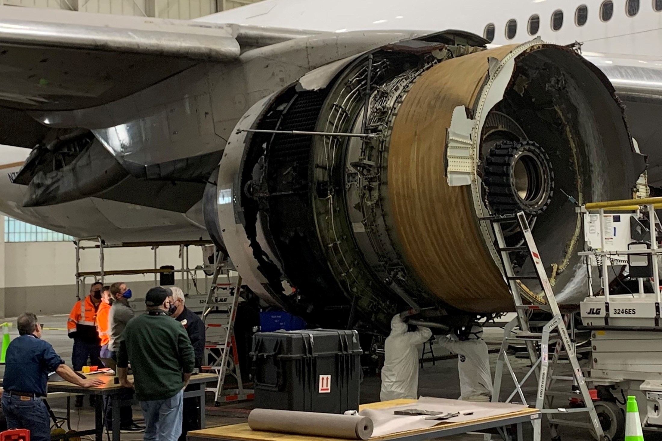 The damaged starboard engine of United Airlines flight 328, a Boeing 777-200, is seen following a February 20 engine failure incident, in a hangar at Denver International Airport in Denver, Colorado, U.S. February 22, 2021. National Transportation Safety Board/Handout via REUTERS.