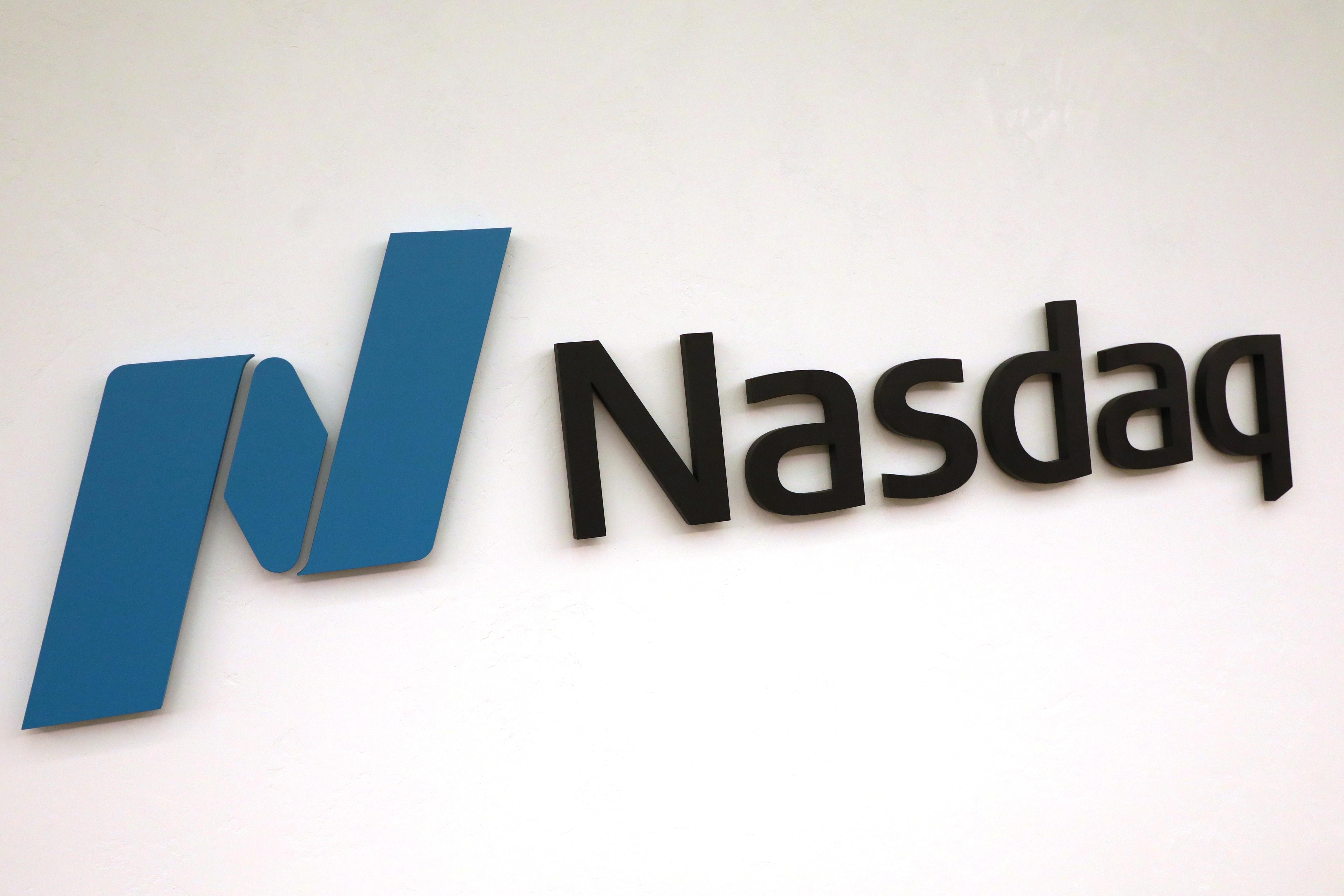 The Nasdaq logo is displayed at the Nasdaq Market site in New York, U.S., May 2, 2019. REUTERS/Brendan McDermid/Files