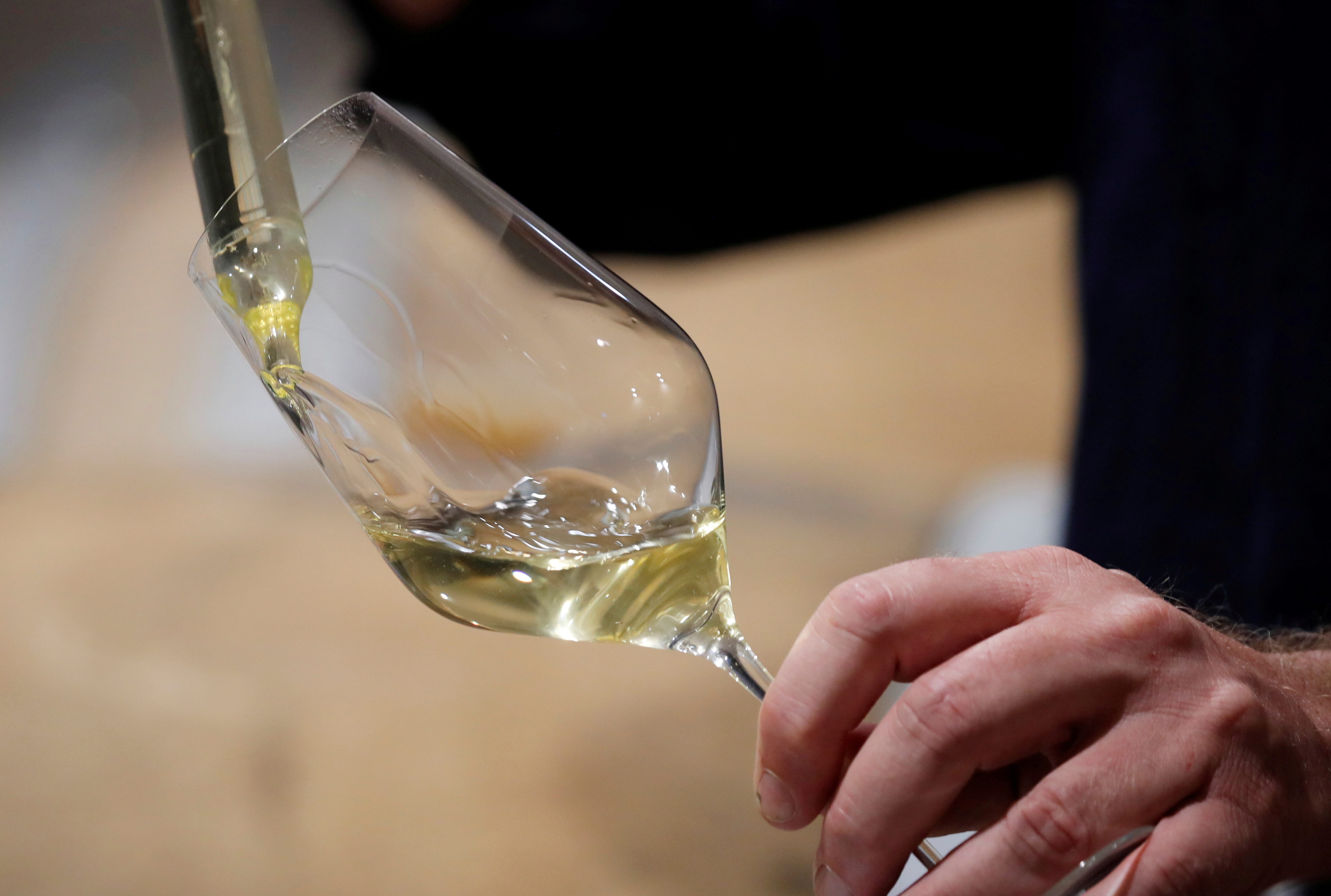 A late wine of Chardonnay is seen in the cellar where bottles of Champagne are left to mature during the traditional Champagne wine harvest in Bethon, France, August 20, 2020. Picture taken August 20, 2020. REUTERS/Charles Platiau/File Photo