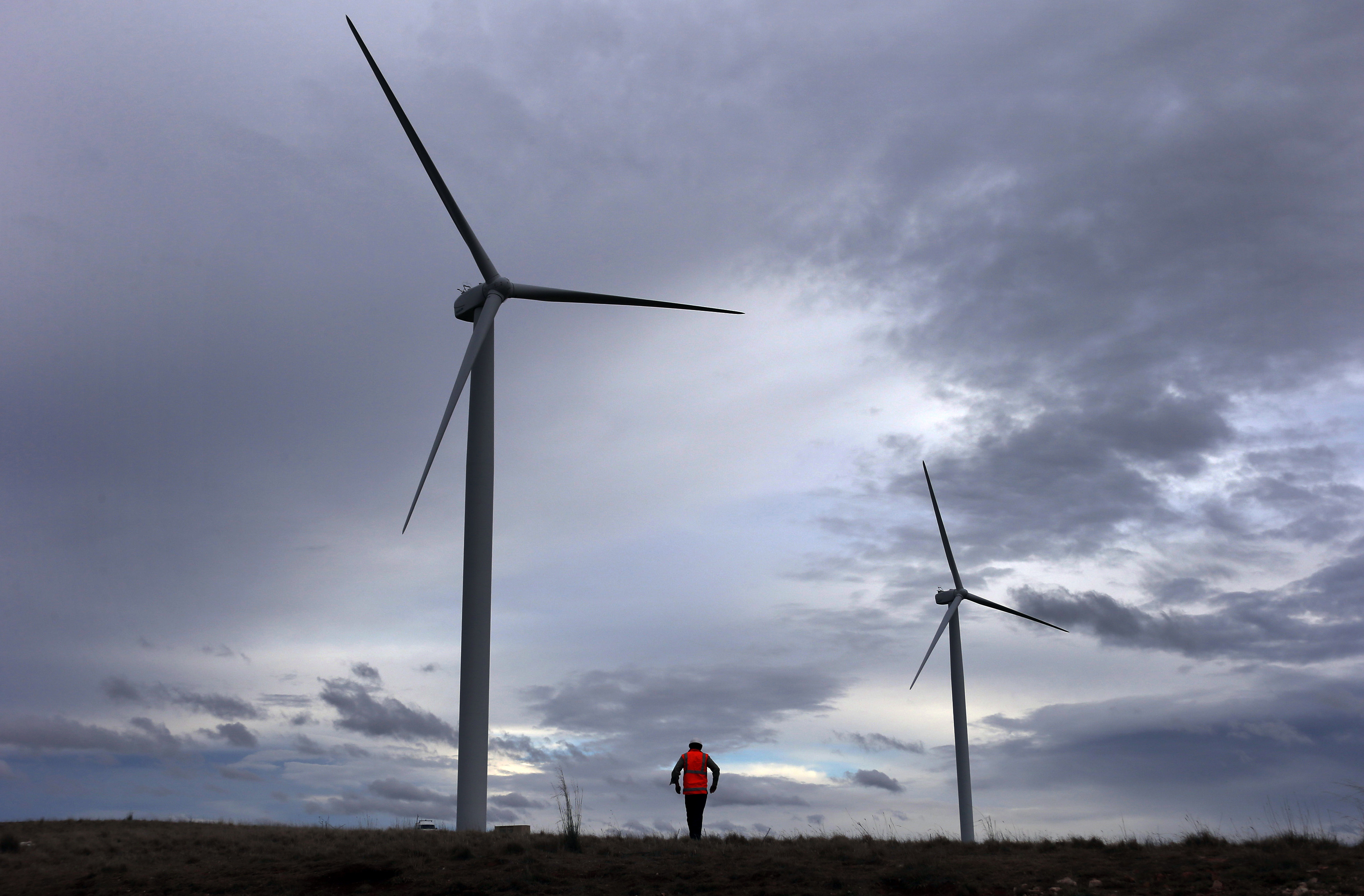 David Brockwell walks between wind turbines during a routine inspection at the Infigen Energy wind farm located on the hills surrounding Lake George, 50 km north of the Australian capital city of Canberra May 13, 2013. Picture taken May 13, 2013. REUTERS/David Gray