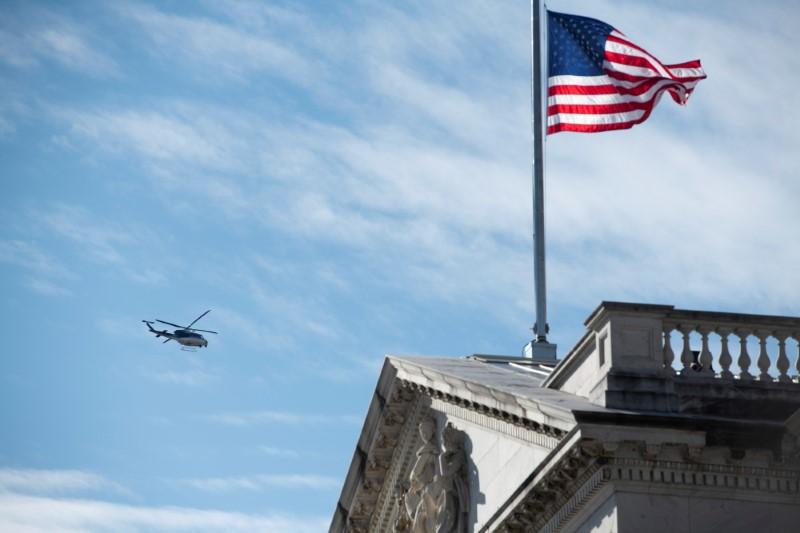 A helicopter flies above the U.S. Capitol during the dress rehearsal ahead of U.S. President-elect Joe Biden's inauguration in Washington, U.S., January 18, 2021. Rod Lamkey/Pool via REUTERS/File Photo