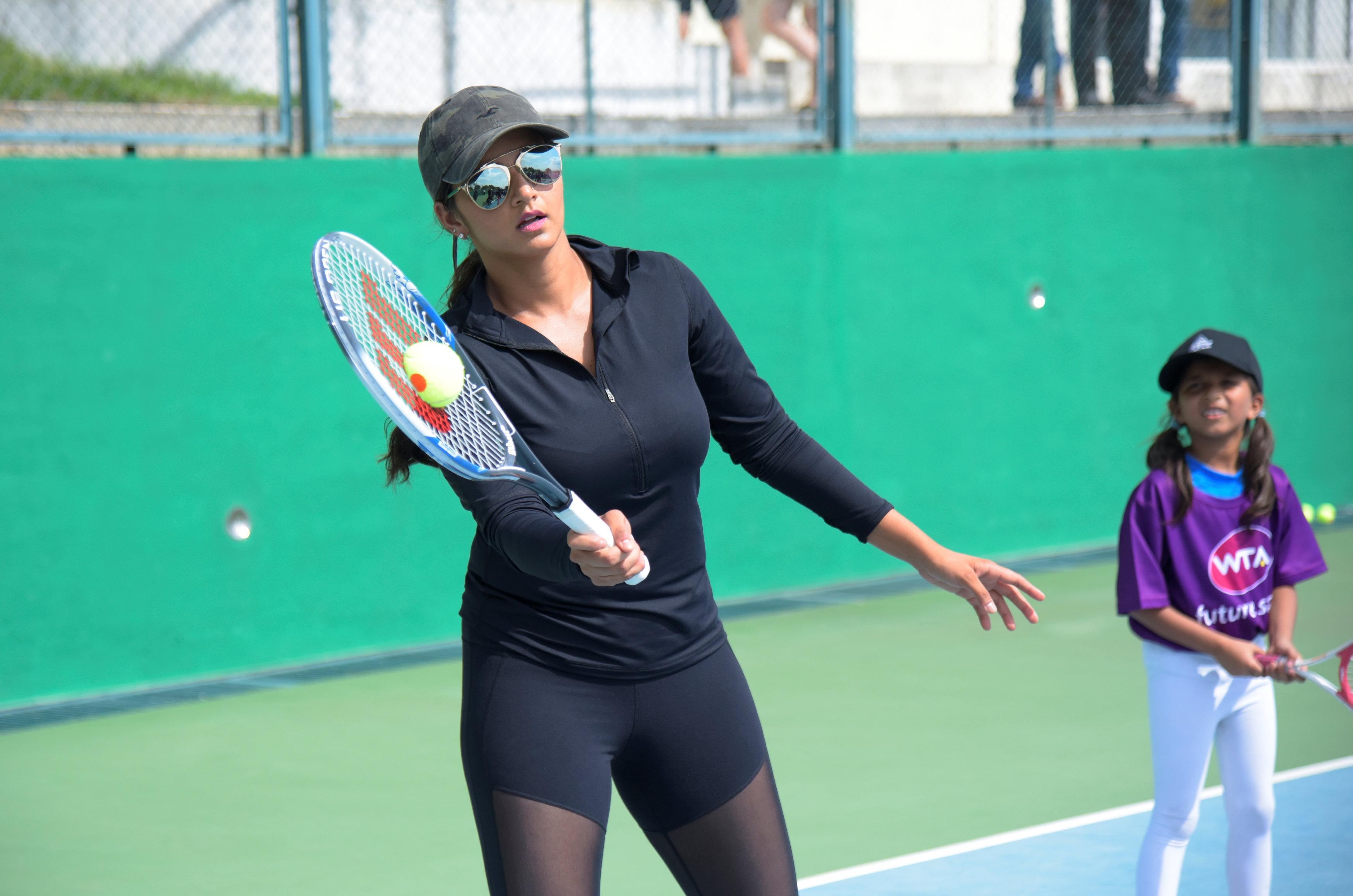 Tennis - WTA Future Stars Masterclass With Sania Mirza and Neha Dhupia - Hyderabad, India - July 25 2017   India's number one tennis player Sania Mirza in action during the WTA Future Stars Masterclass   Reuters Plus/ Krishnendu Halder