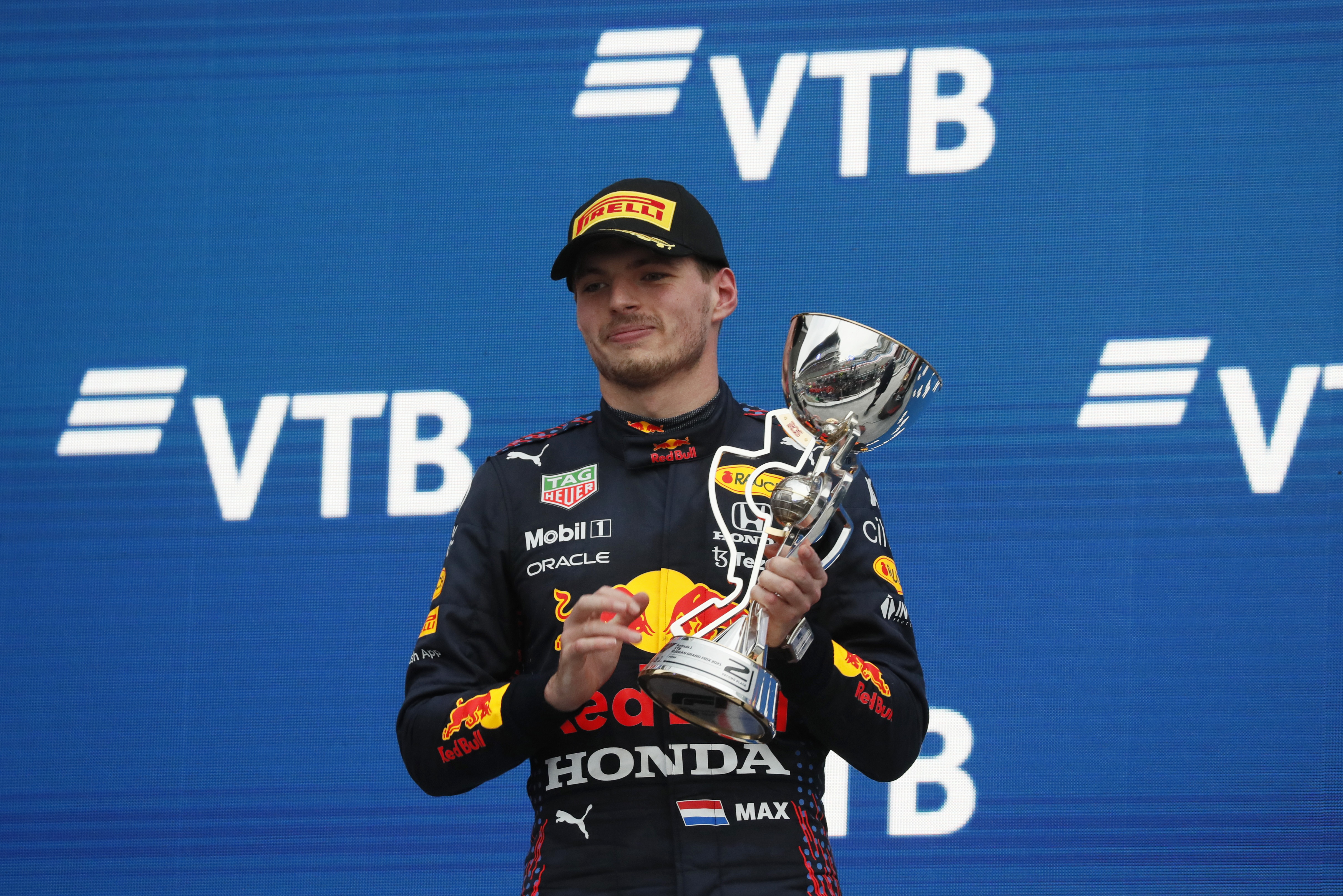Formula One F1 - Russian Grand Prix - Sochi Autodrom, Sochi, Russia - September 26, 2021 Red Bull's Max Verstappen celebrates on the podium with the trophy after finishing second in the race Pool via REUTERS/Yuri Kochetkov