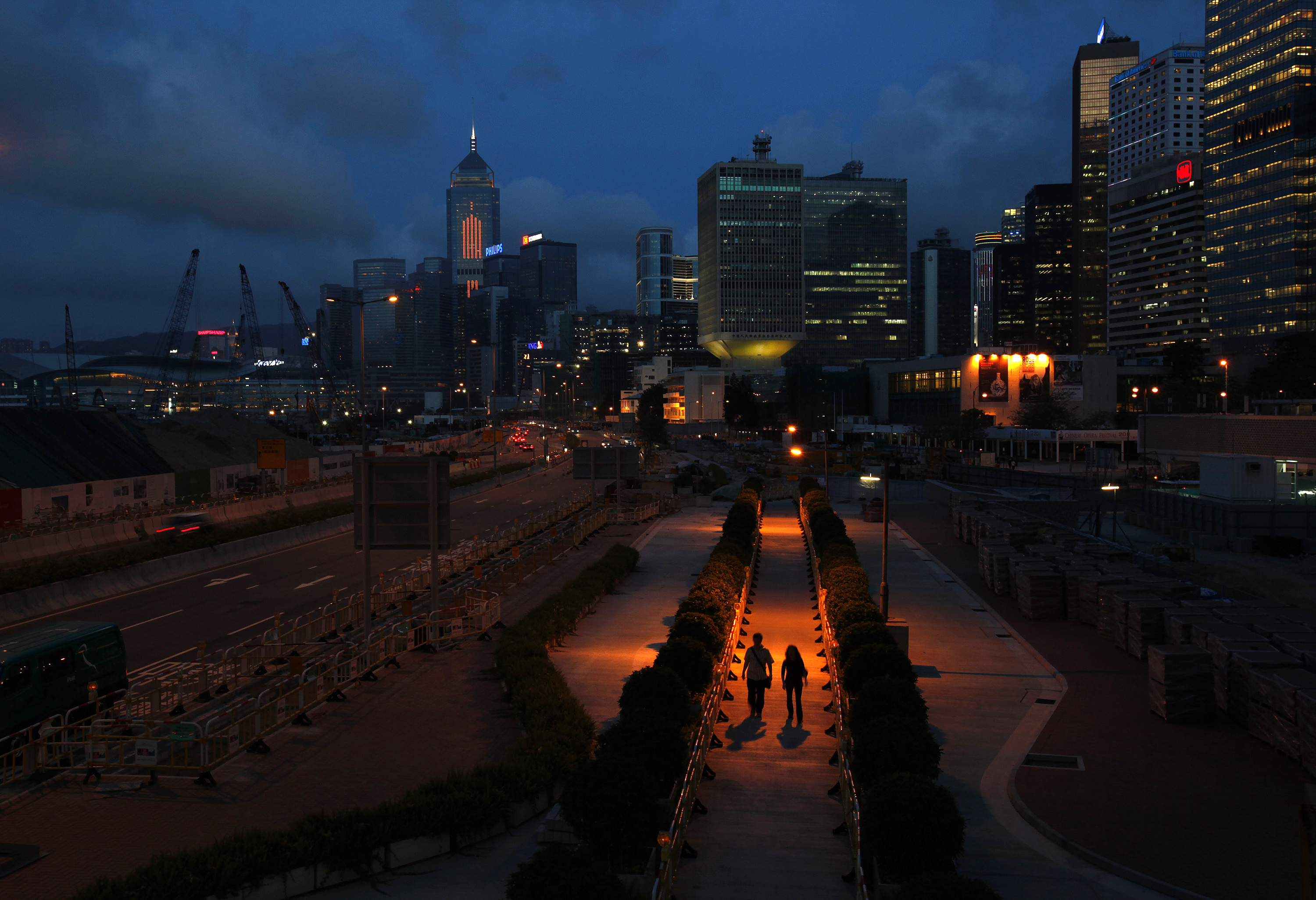 People walk on a pavement at Hong Kong's financial Central district during sunset May 11, 2011. REUTERS/Bobby Yip