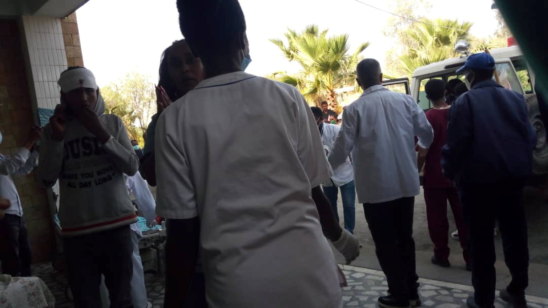 People gather as victims arrive at Ayder Referral Hospital, in Mekelle, after an airstrike in Togoga, Ethiopia's Tigray region June 22, 2021. Picture taken June 22, 2021. Tigray Guardians 24 via REUTERS