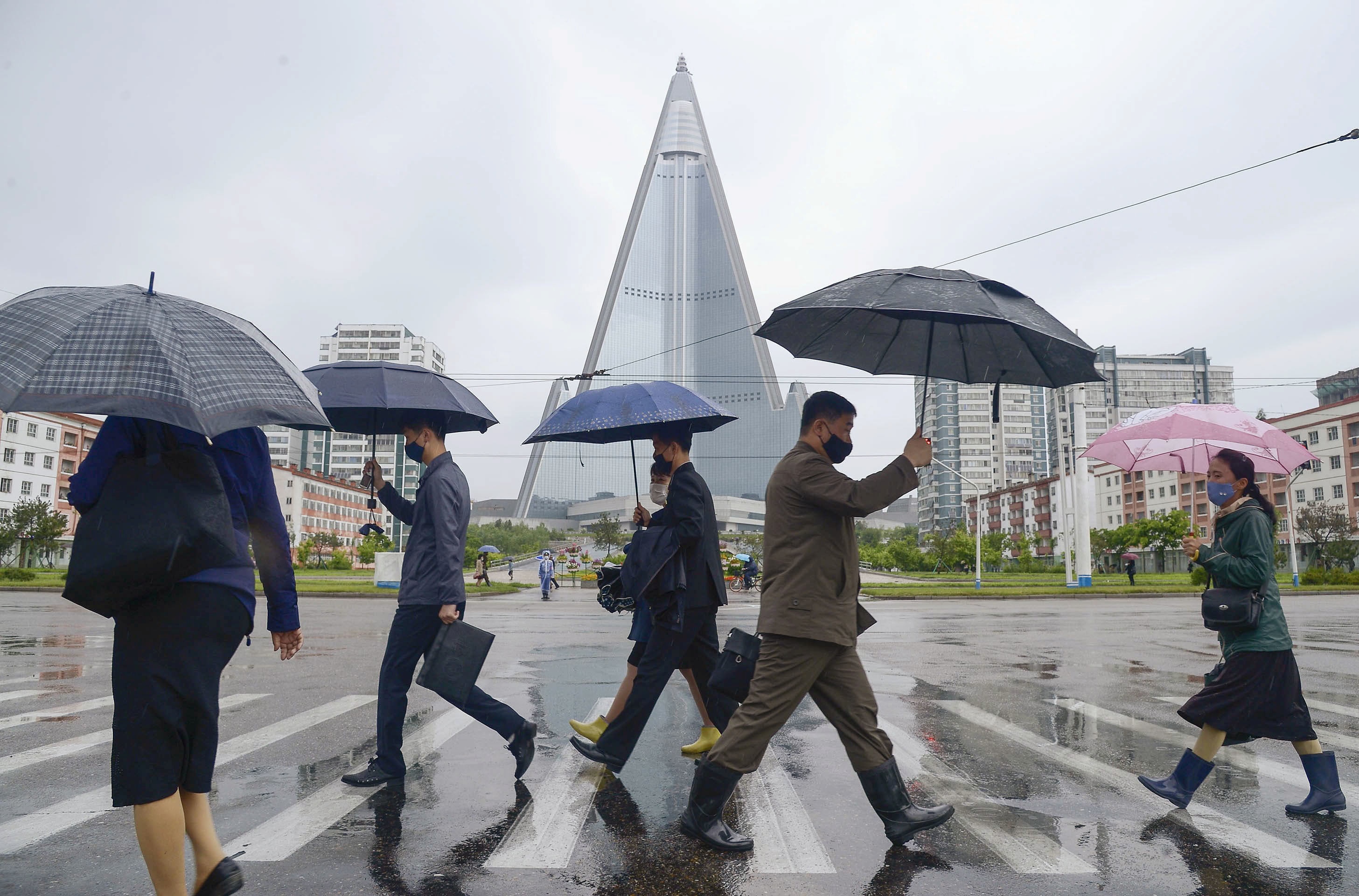 People wearing protective face masks walk amid concerns over the new coronavirus disease (COVID-19) in Pyongyang, North Korea May 15, 2020, in this photo released by Kyodo. Mandatory credit Kyodo/via REUTERS