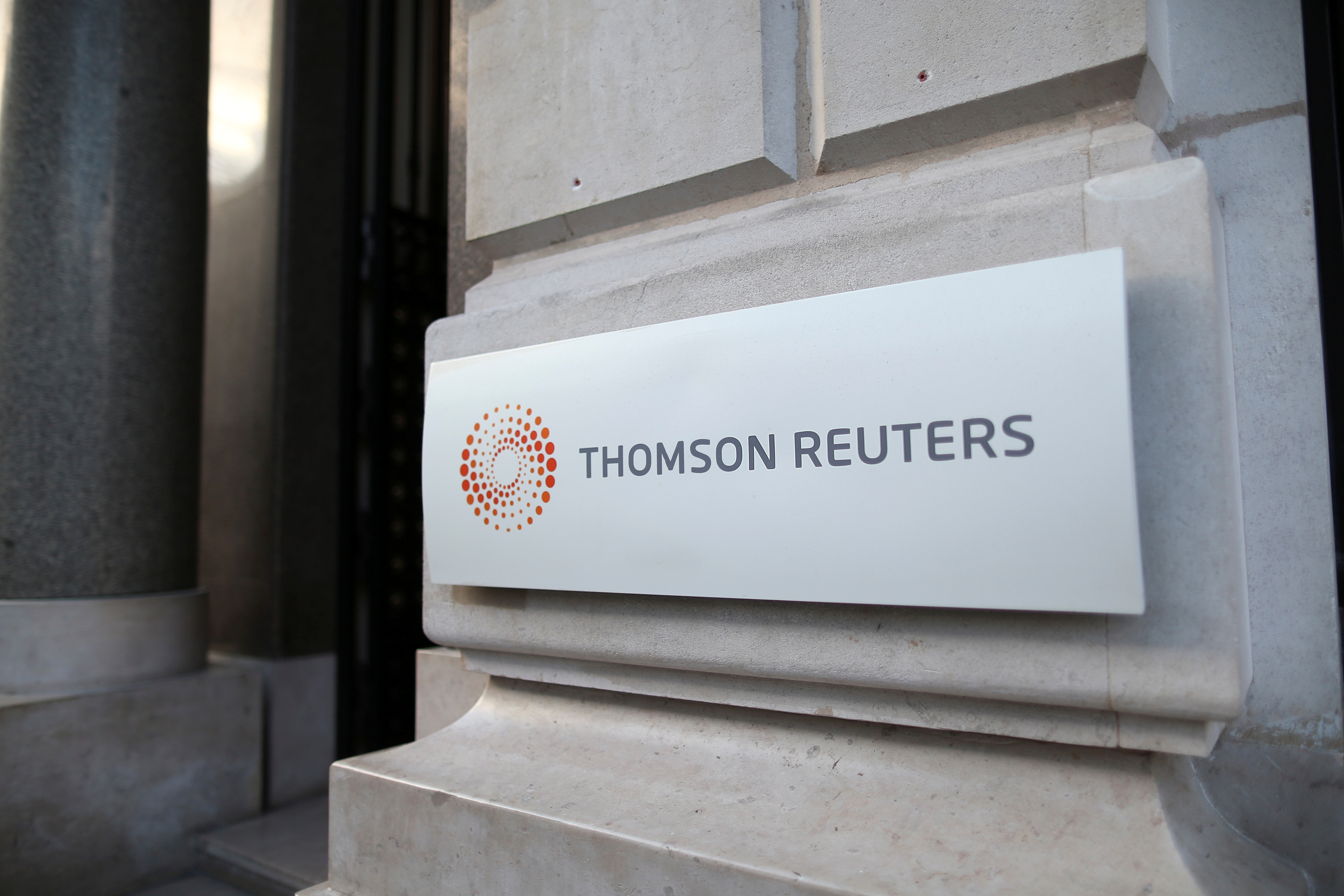 The logo of Thomson Reuters is pictured at the entrance of its Paris headquarters, France, March 7, 2016.   REUTERS/Charles Platiau