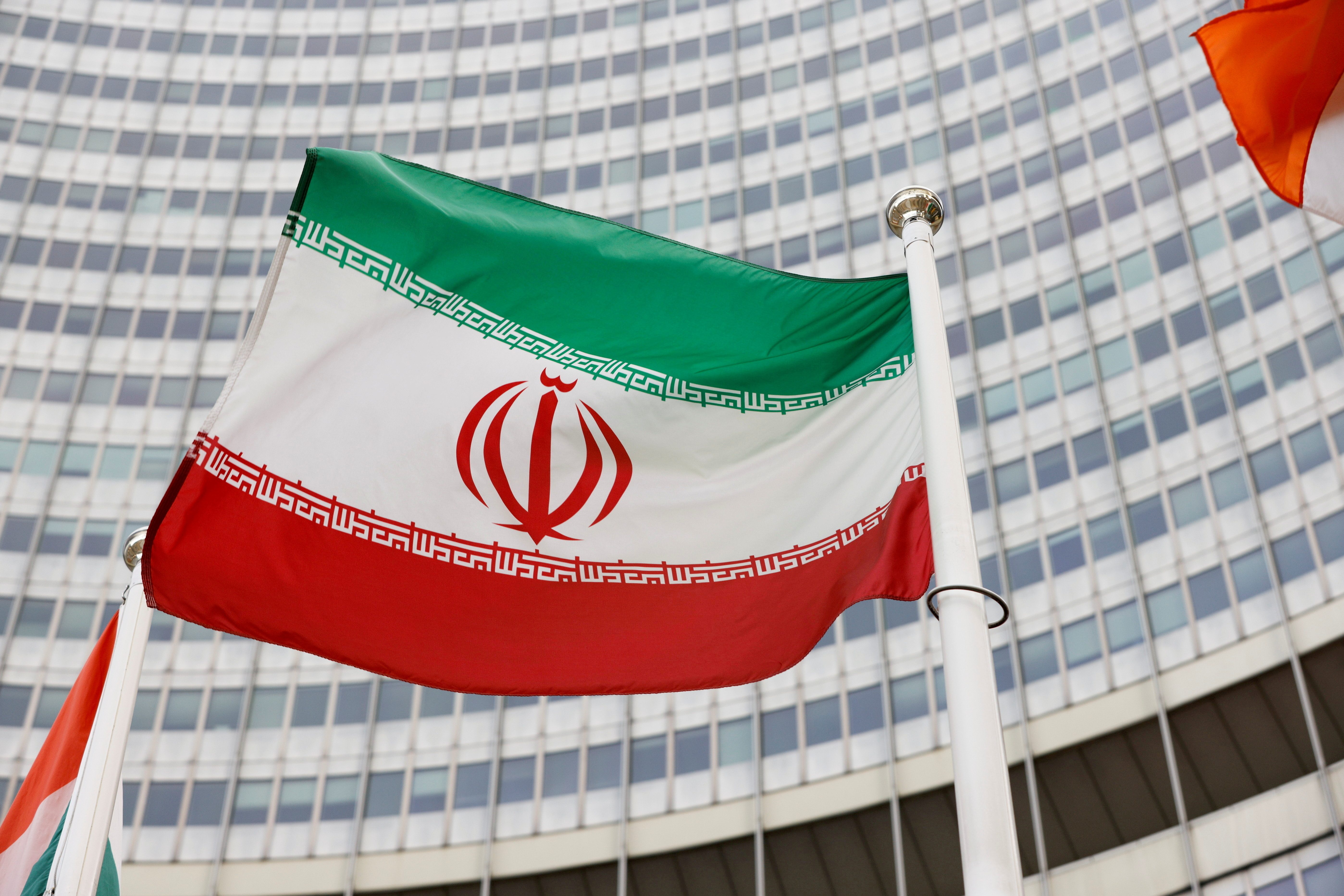 FILE PHOTO: The Iranian flag waves in front of the International Atomic Energy Agency (IAEA) headquarters, amid the coronavirus disease (COVID-19) pandemic, in Vienna, Austria May 23, 2021. REUTERS/Leonhard Foeger/File Photo
