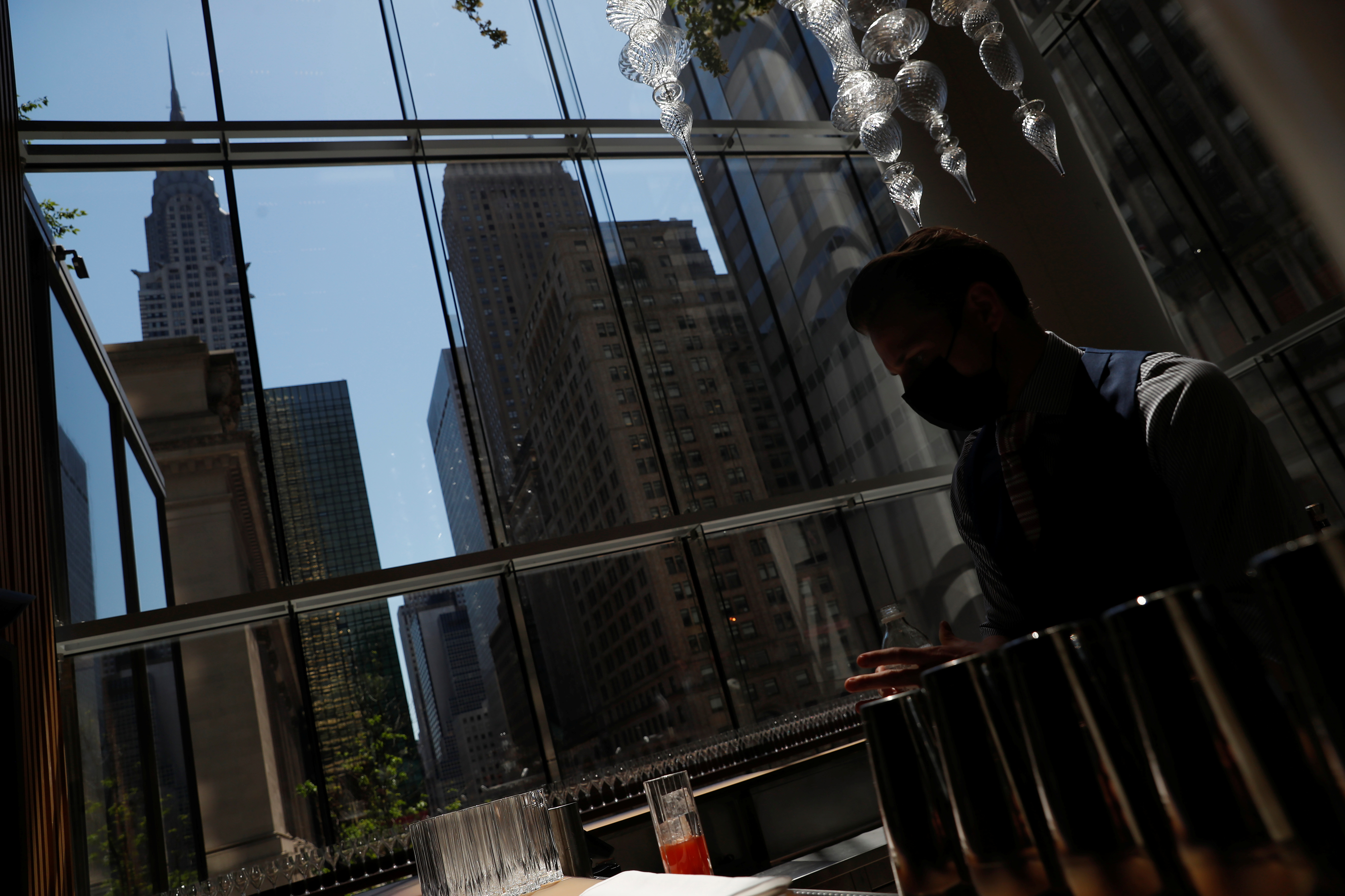 A man works at Chef Daniel Boulud's new restaurant Le Pavillon at One Vanderbilt in New York City, U.S., May 19, 2021. REUTERS/Shannon Stapleton
