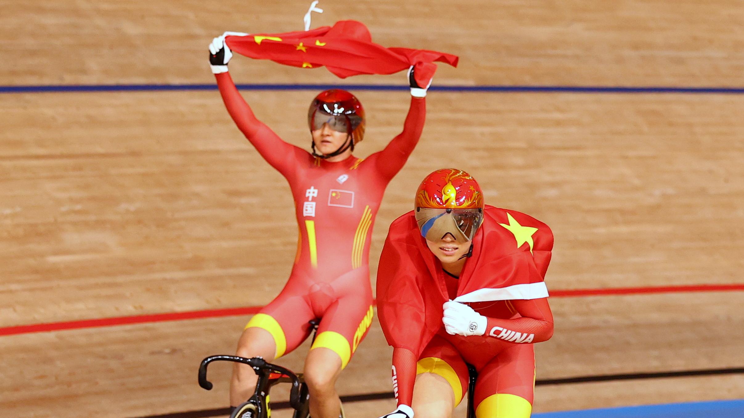 Tokyo 2020 Olympics - Cycling - Track - Women's Team Sprint - Gold Final - Izu Velodrome, Shizuoka, Japan - August 2, 2021. Bao Shanju of China and Zhong Tianshi of China celebrate winning the race and the gold medal REUTERS/Matthew Childs
