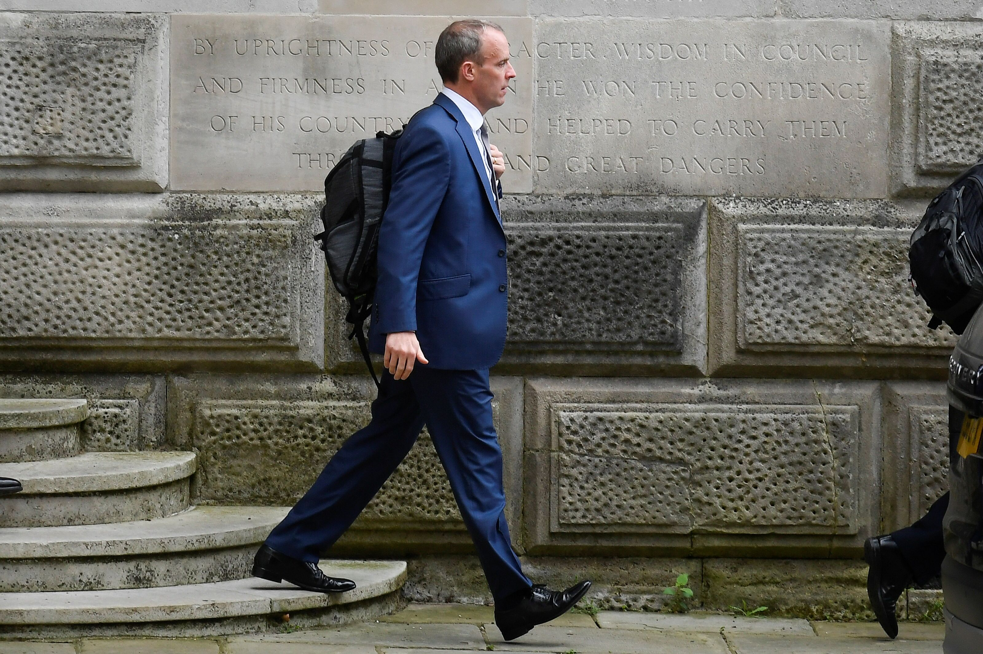 Britain's Foreign Secretary Dominic Raab walks outside the FCDO in London, Britain, September 15, 2021. REUTERS/Toby Melville
