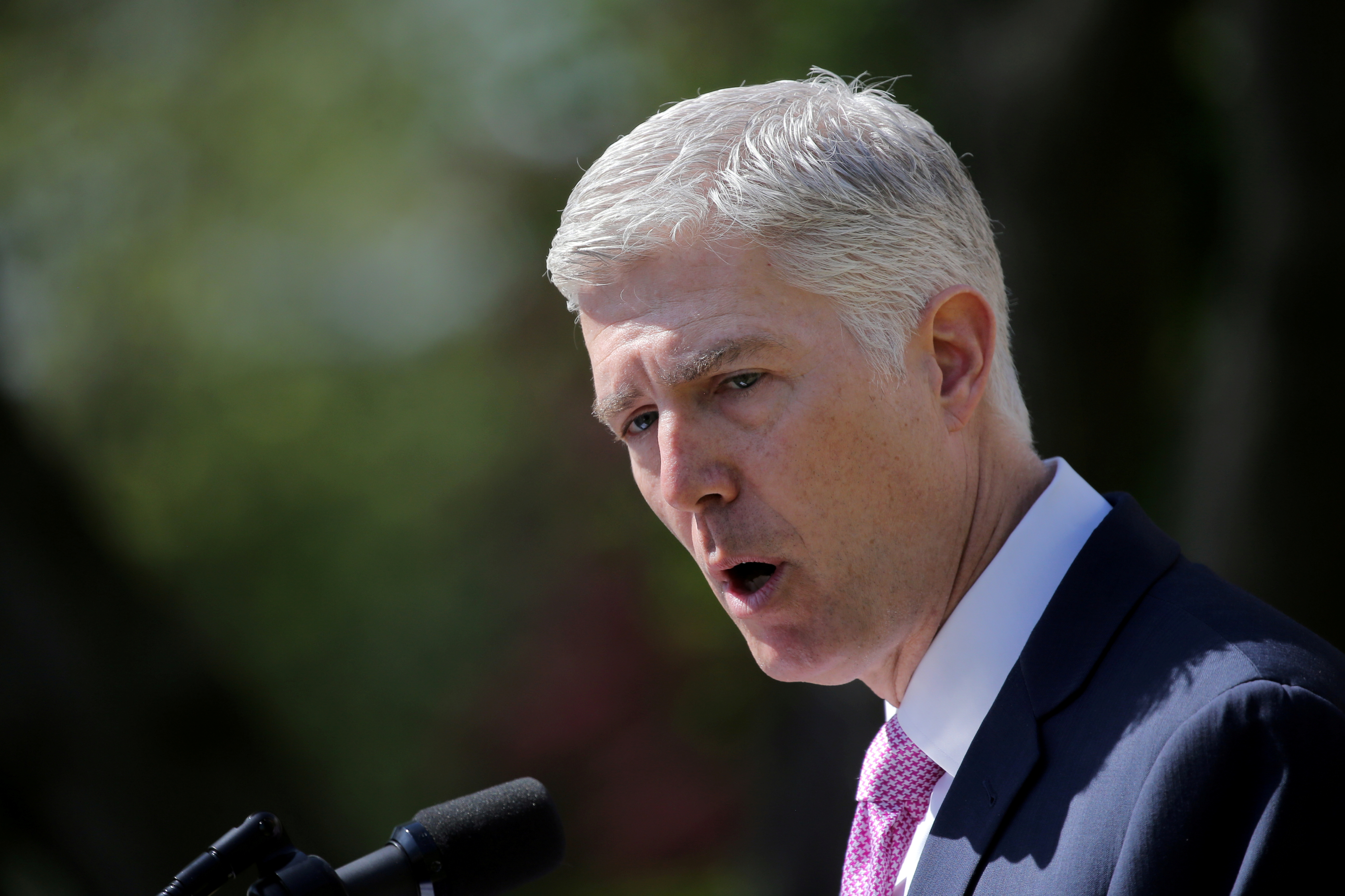 Judge Neil Gorsuch speaks after his swearing as an associate justice of the Supreme Court in the Rose Garden of the White House in Washington, U.S., April 10, 2017. REUTERS/Carlos Barria/File Photo