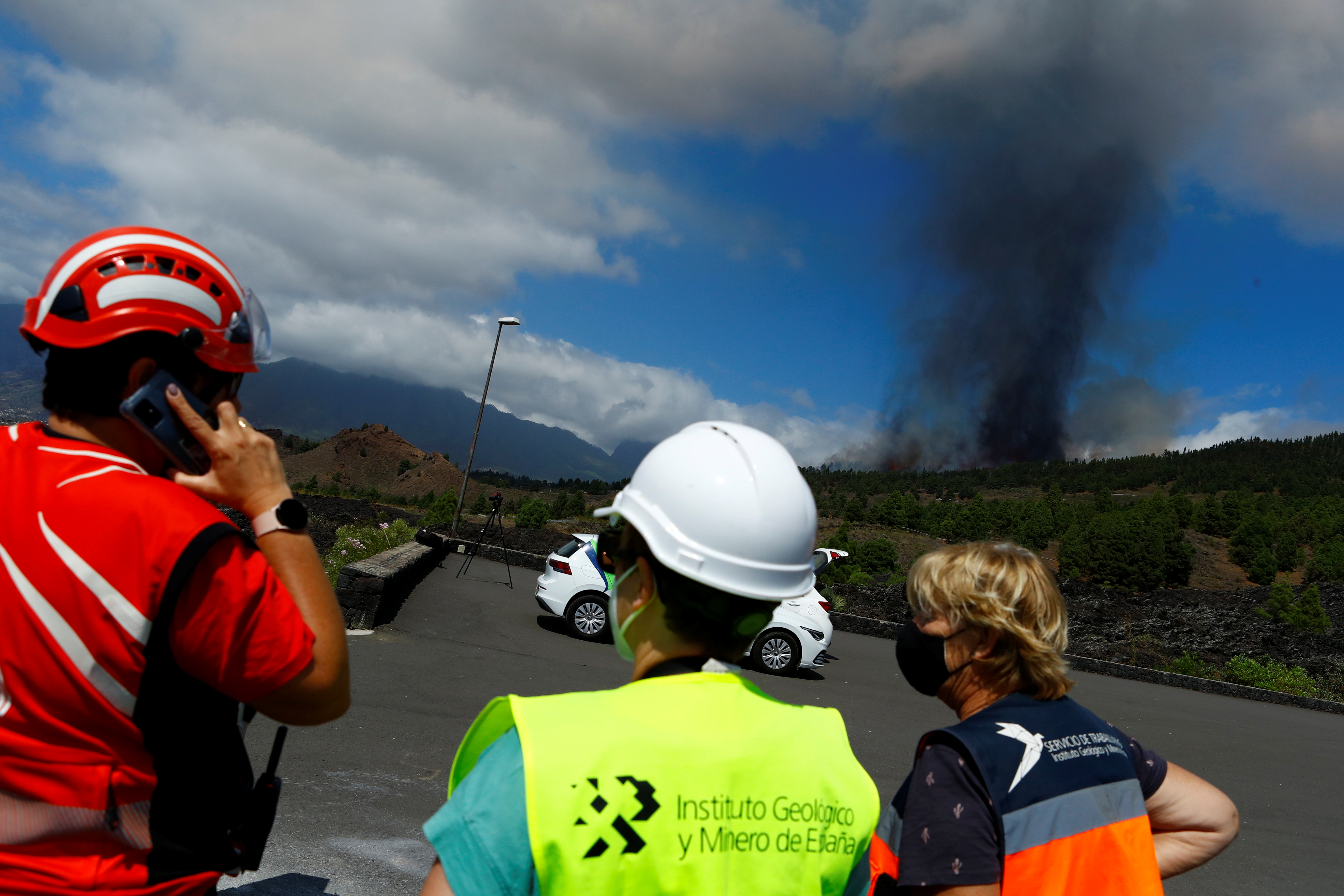 A plume of smoke rises following the eruption of a volcano in the Cumbre Vieja national park at El Paso, on the Canary Island of La Palma, September 19, 2021. REUTERS/Borja Suarez