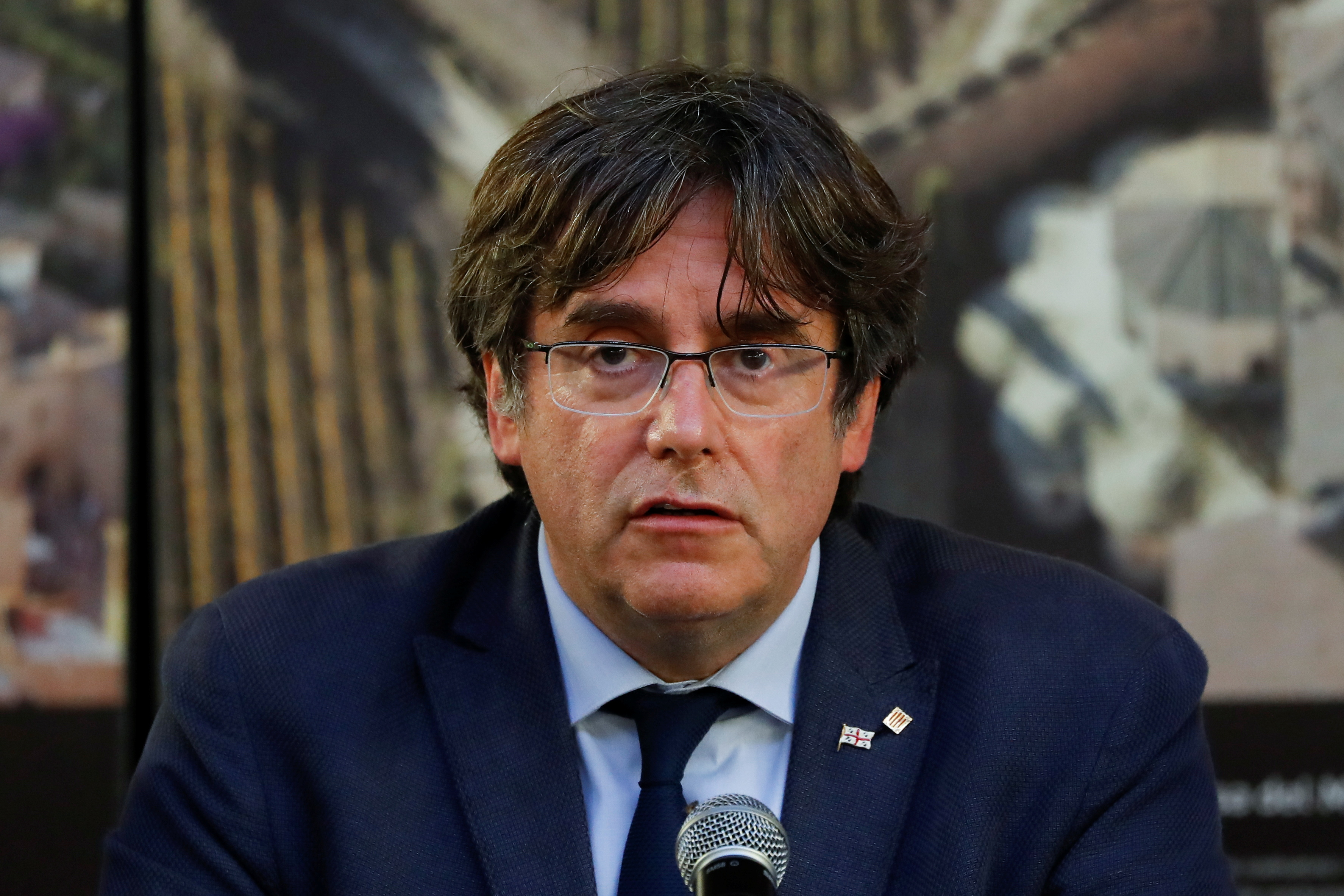 Former Catalan government head Carles Puigdemont attends a news conference in Alghero, Italy, September 26, 2021. REUTERS/Yara Nardi