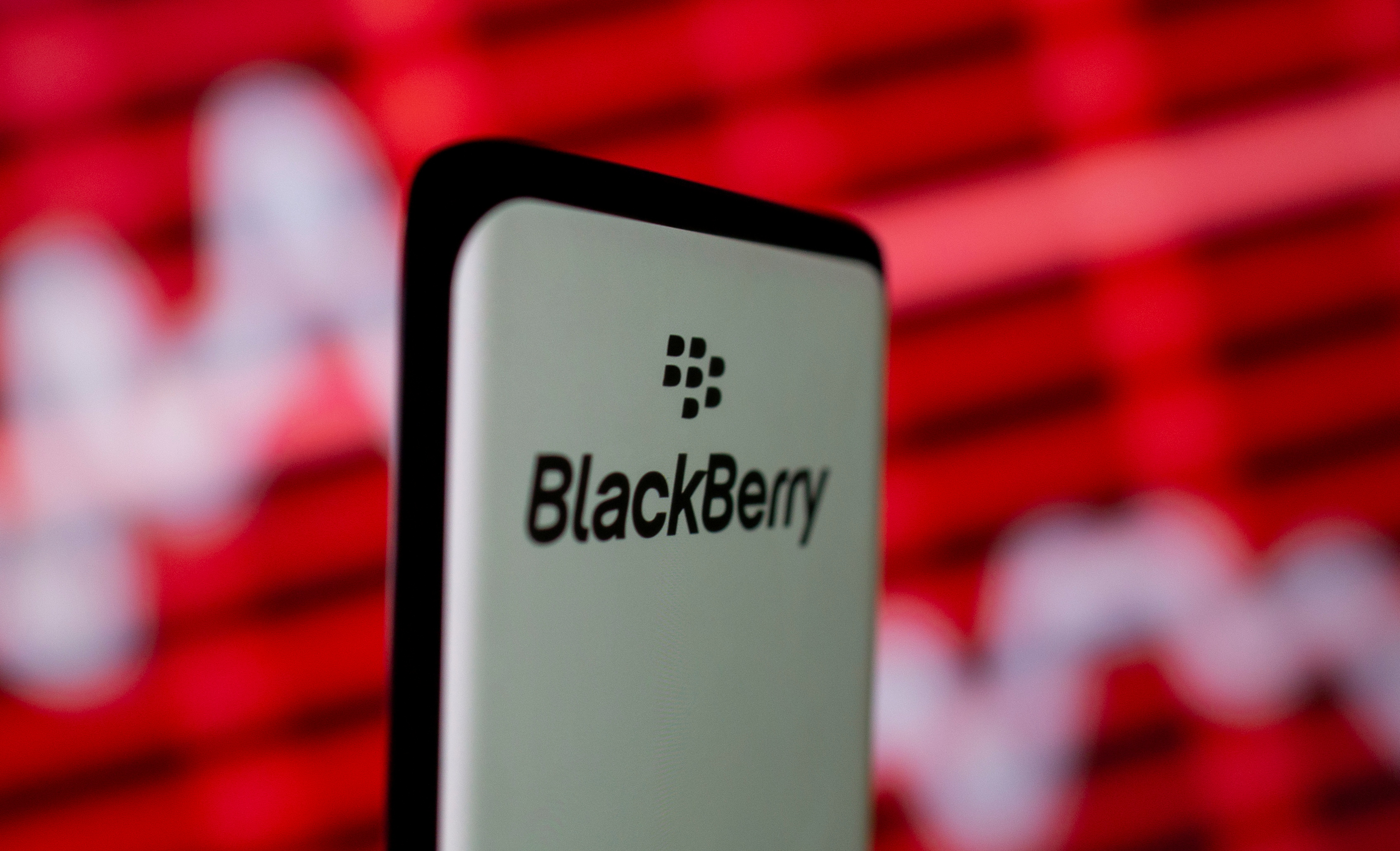 The Blackberry logo is seen on a smartphone in front of a displayed stock graph in this illustration taken February 5, 2021. REUTERS/Dado Ruvic/Illustration
