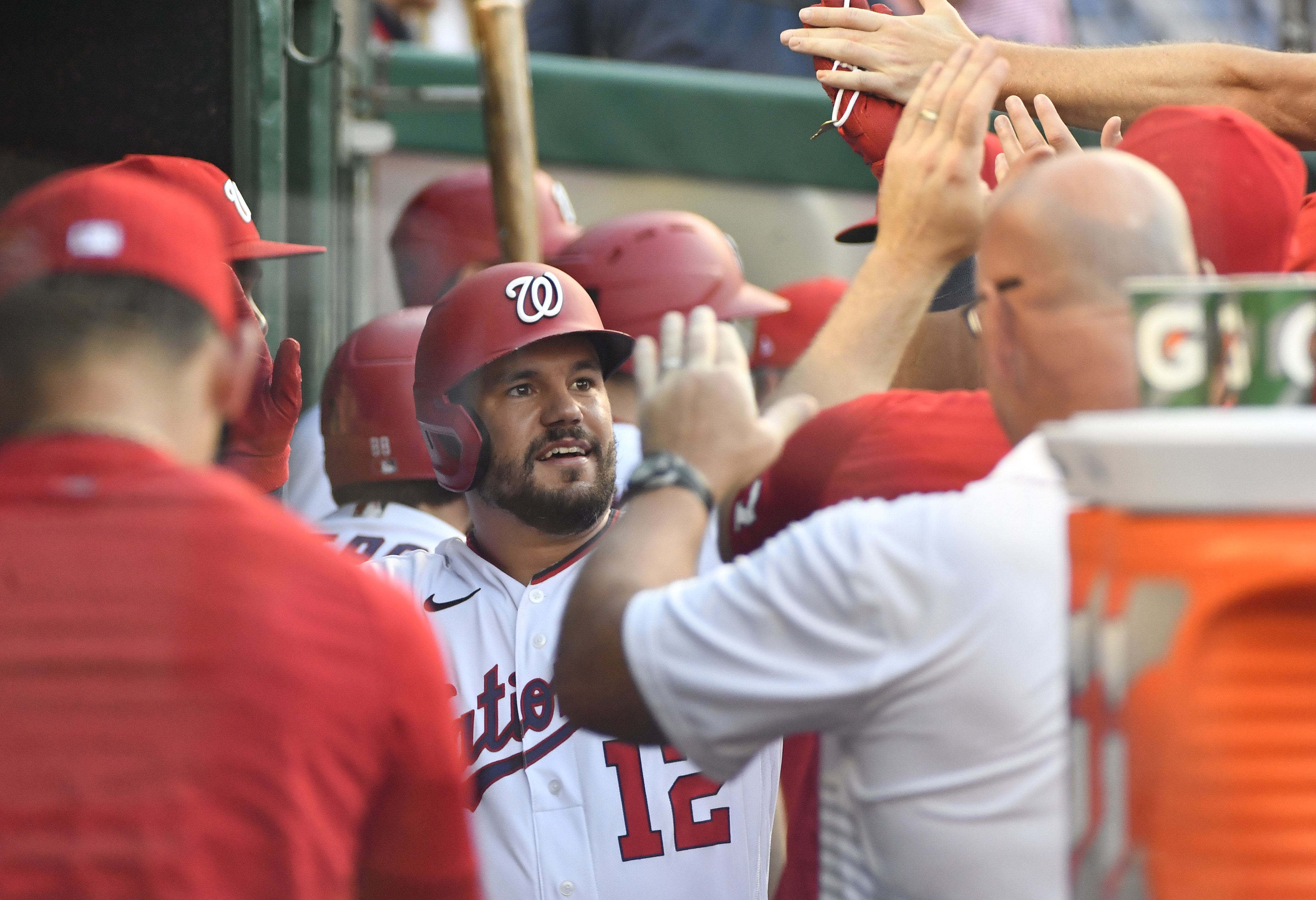 Jun 29, 2021; Washington, District of Columbia, USA; Washington Nationals left fielder Kyle Schwarber (12) is congratulated by teammates after hitting a solo home run against the Tampa Bay Rays during the first inning at Nationals Park. Mandatory Credit: Brad Mills-USA TODAY Sports