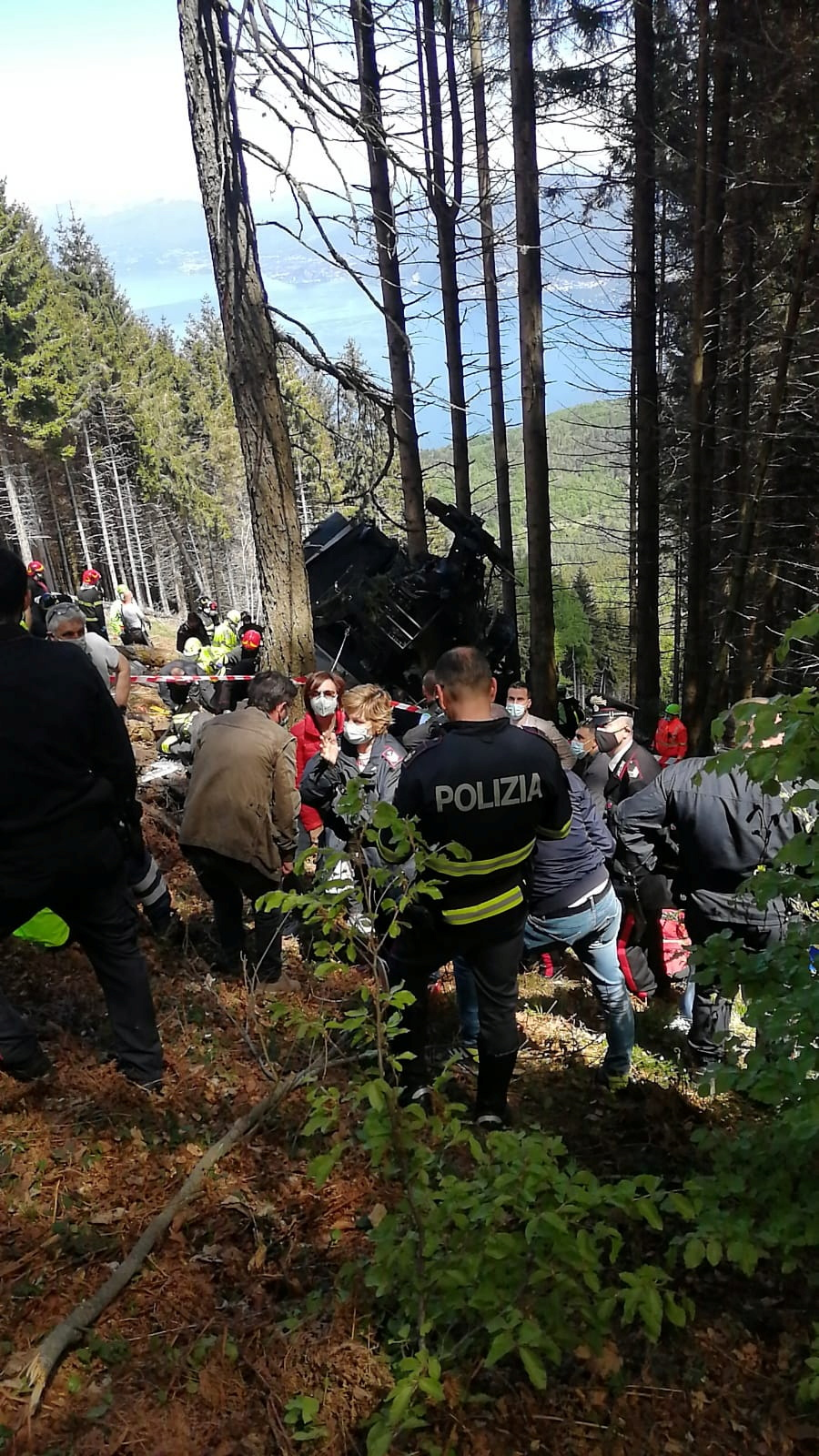 Police and rescue service members are seen near the crashed cable car after it collapsed in Stresa, near Lake Maggiore, Italy May 23, 2021. ITALIAN POLICE/Handout via REUTERS