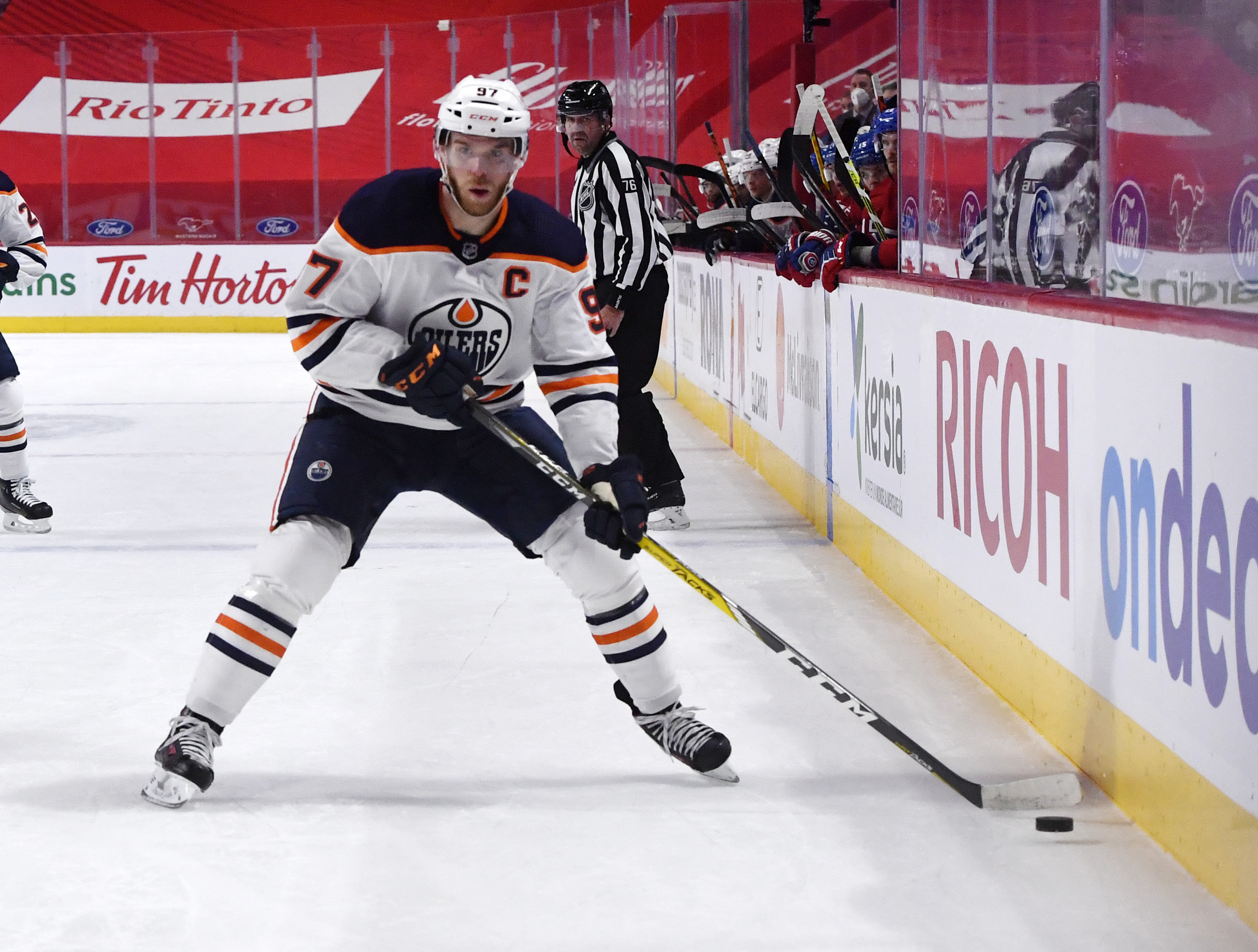 May 10, 2021; Montreal, Quebec, CAN; Edmonton Oilers forward Connor McDavid (97) plays the puck during the first period of the game against the Montreal Canadiens at the Bell Centre. Mandatory Credit: Eric Bolte-USA TODAY Sports