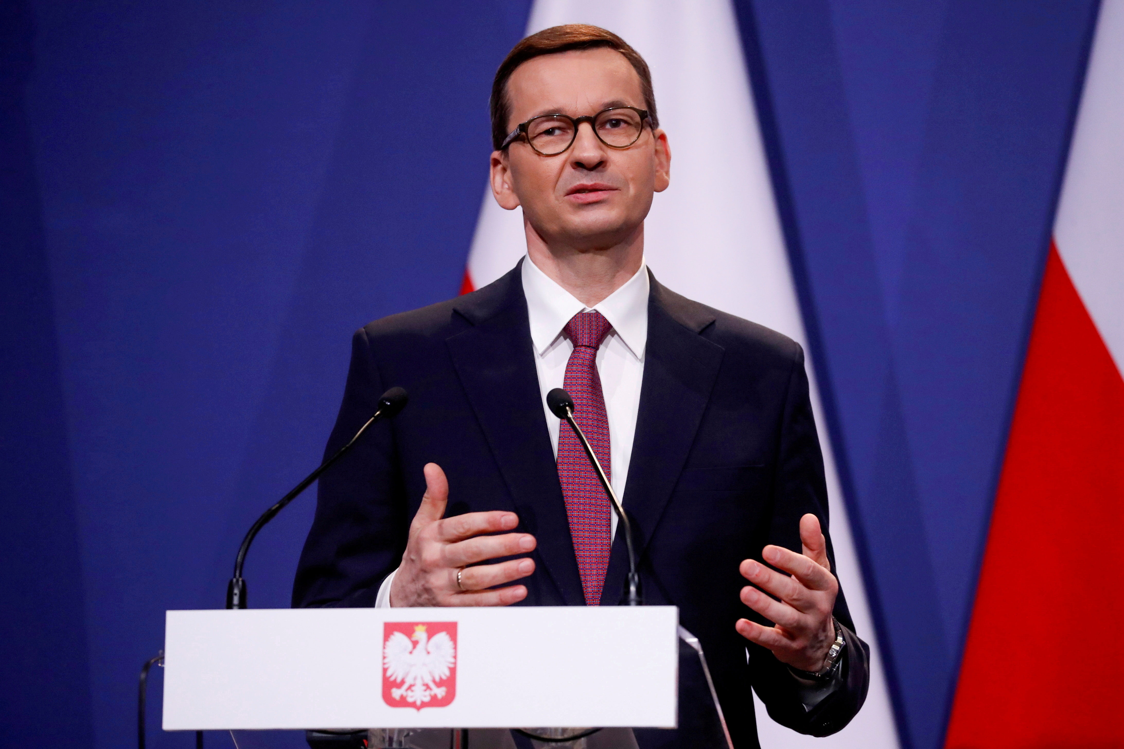 Polish Prime Minister Mateusz Morawiecki gives a statement after meeting with Hungarian Prime Minister Viktor Orban and Italy's League party leader Matteo Salvini in Budapest, Hungary, April 1, 2021. REUTERS/Bernadett Szabo