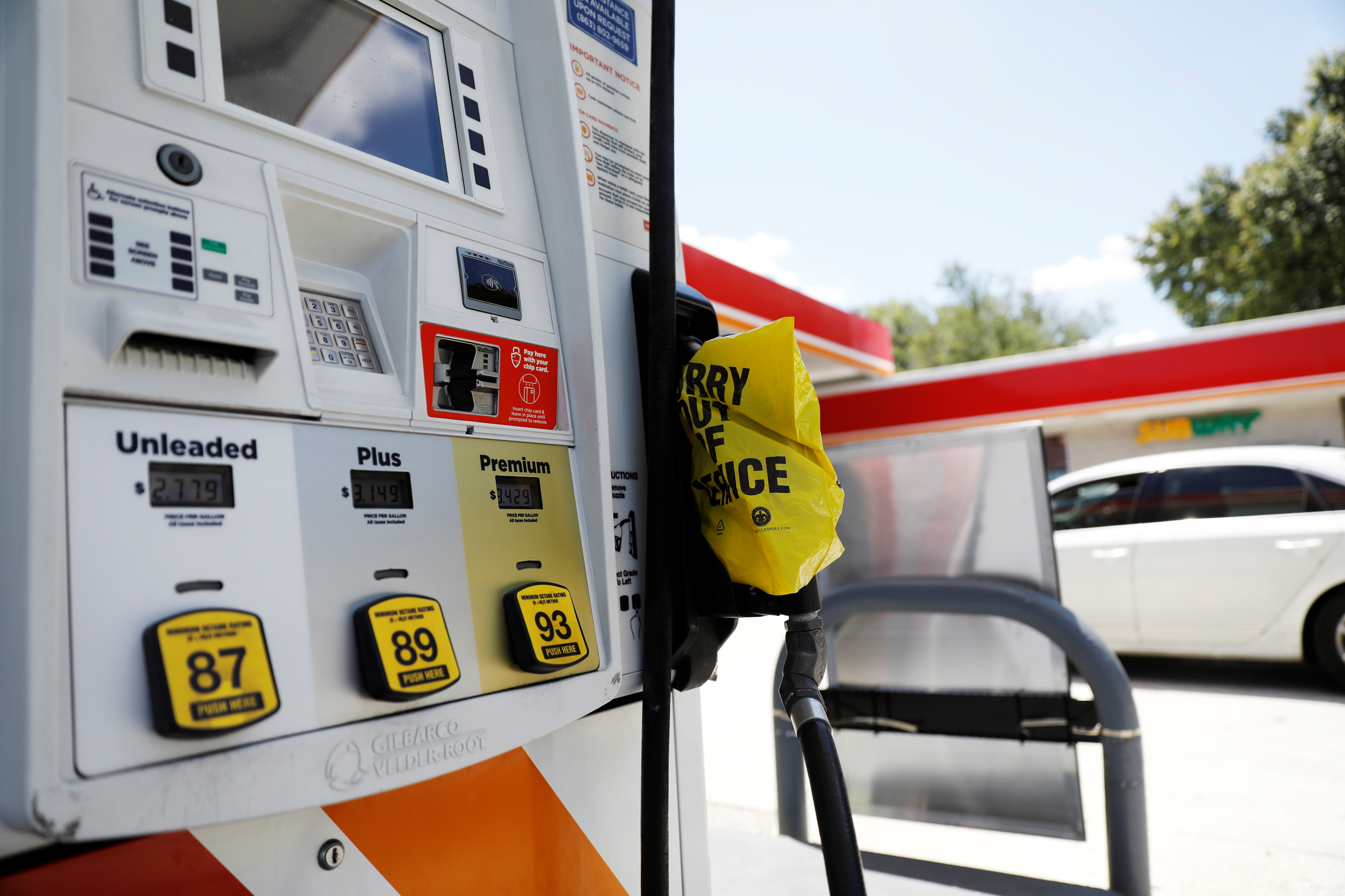 A plastic bag covering a fuel pump to signal no gas is available is seen at a gas station after a cyberattack crippled the biggest fuel pipeline in the country, run by Colonial Pipeline, in Lakeland, Florida, U.S. May 14, 2021.  REUTERS/Octavio Jones