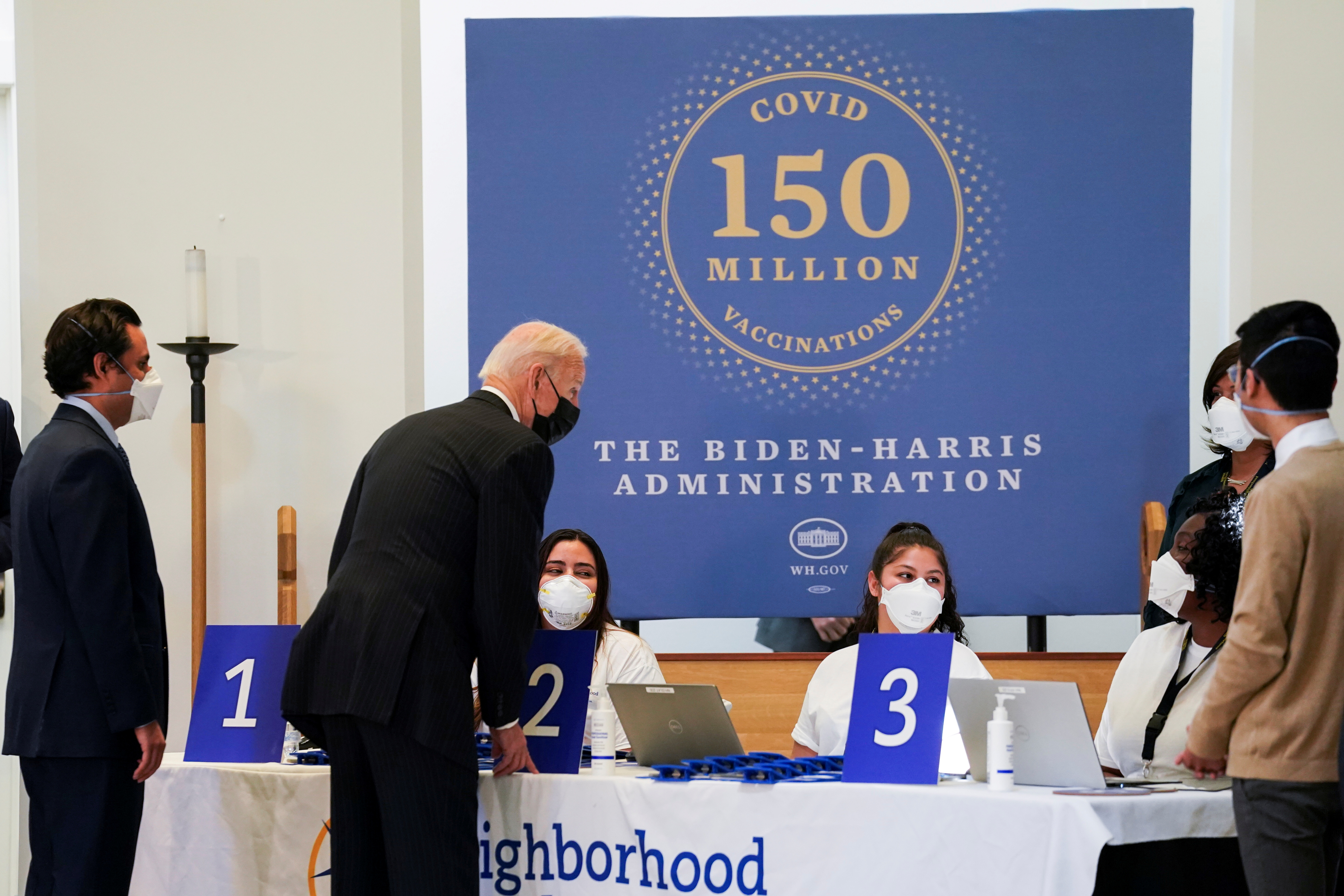 U.S. President Joe Biden speaks with medical workers during a visit to a coronavirus disease (COVID-19) vaccination site at Virginia Theological Seminary in Alexandria, Virginia, U.S., April 6, 2021. REUTERS/Kevin Lamarque/File Photo