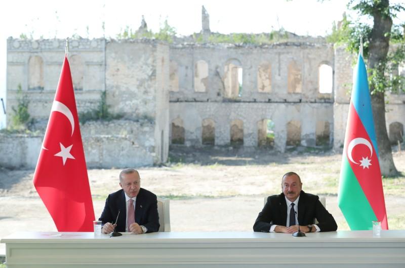 Turkey's President Tayyip Erdogan and Azerbaijan's President Ilham Aliyev attend a signing ceremony in Shusha in Nagorno-Karabakh region, Azerbaijan June 15, 2021. Presidential Press Office/Handout via REUTERS