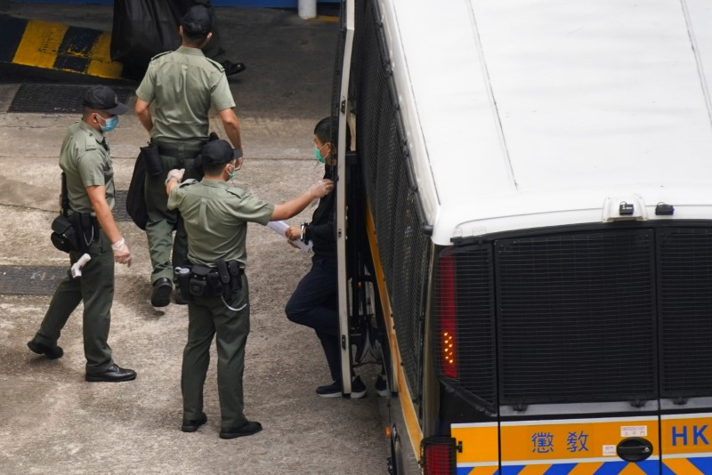 Apple Daily's editor-in-chief Ryan Law arrives at Lai Chi Kok Reception Centre by a prison van after he remained in custody over the national security law charge, in Hong Kong, China June 19, 2021. REUTERS/Lam Yik