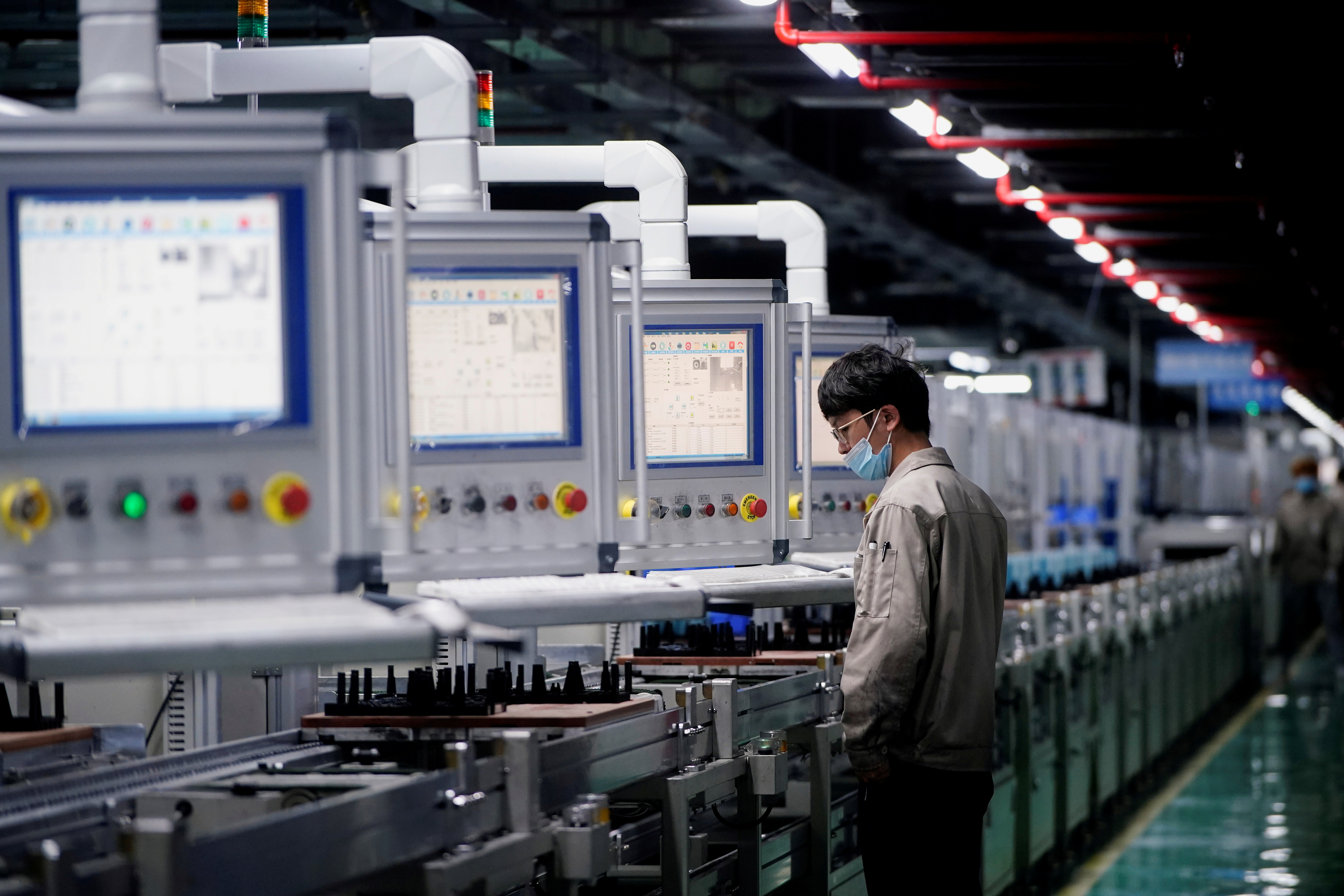 An employee works on the production line of electric vehicle (EV) battery manufacturer Octillion in Hefei, Anhui province, China March 30, 2021. Picture taken March 30, 2021. REUTERS/Aly Song