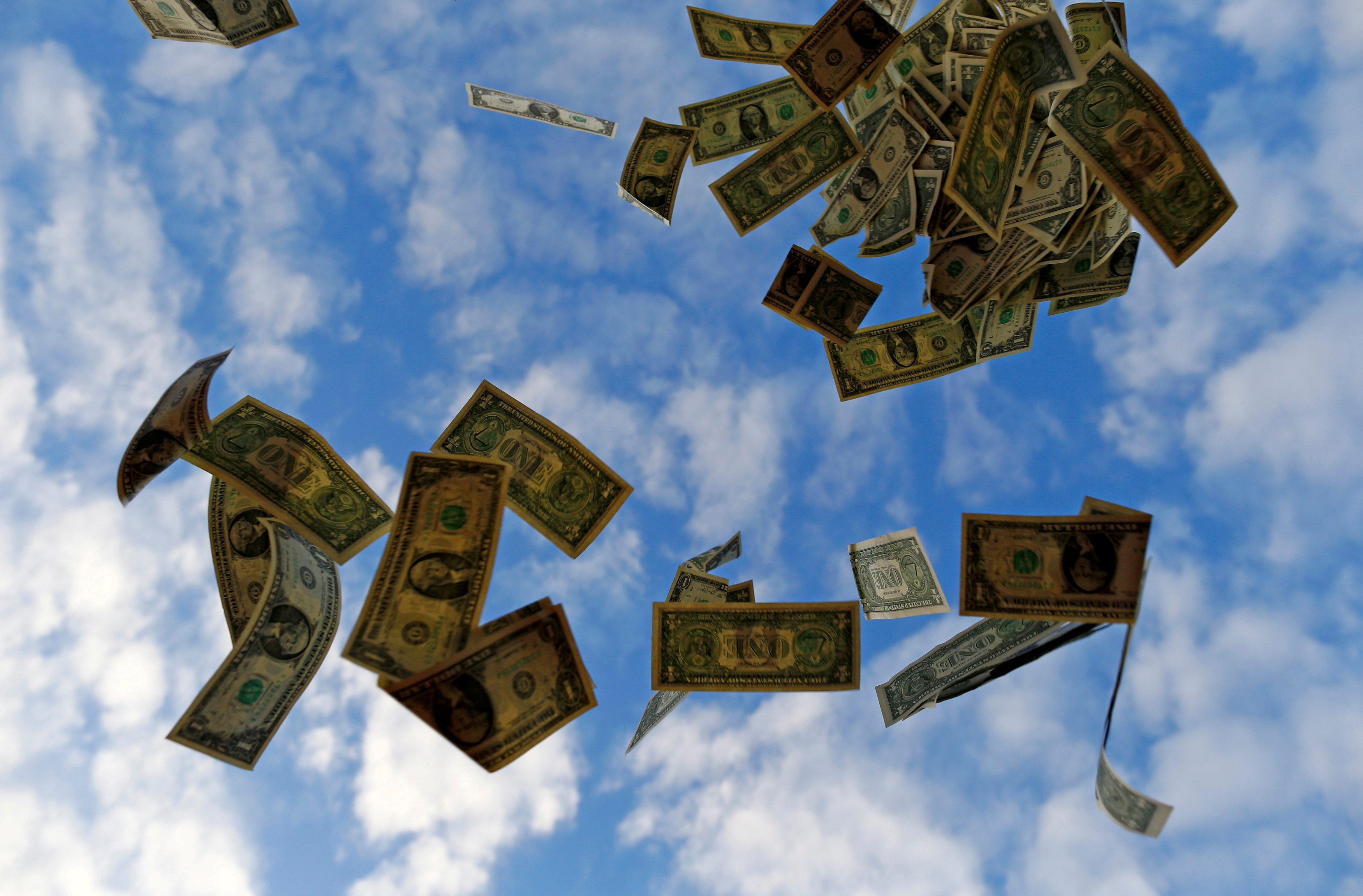 U.S. dollar bills blow near the Andalusian capital of Seville  in this photo illustration taken on November 16, 2014.  REUTERS/Marcelo Del Pozo/File Photo