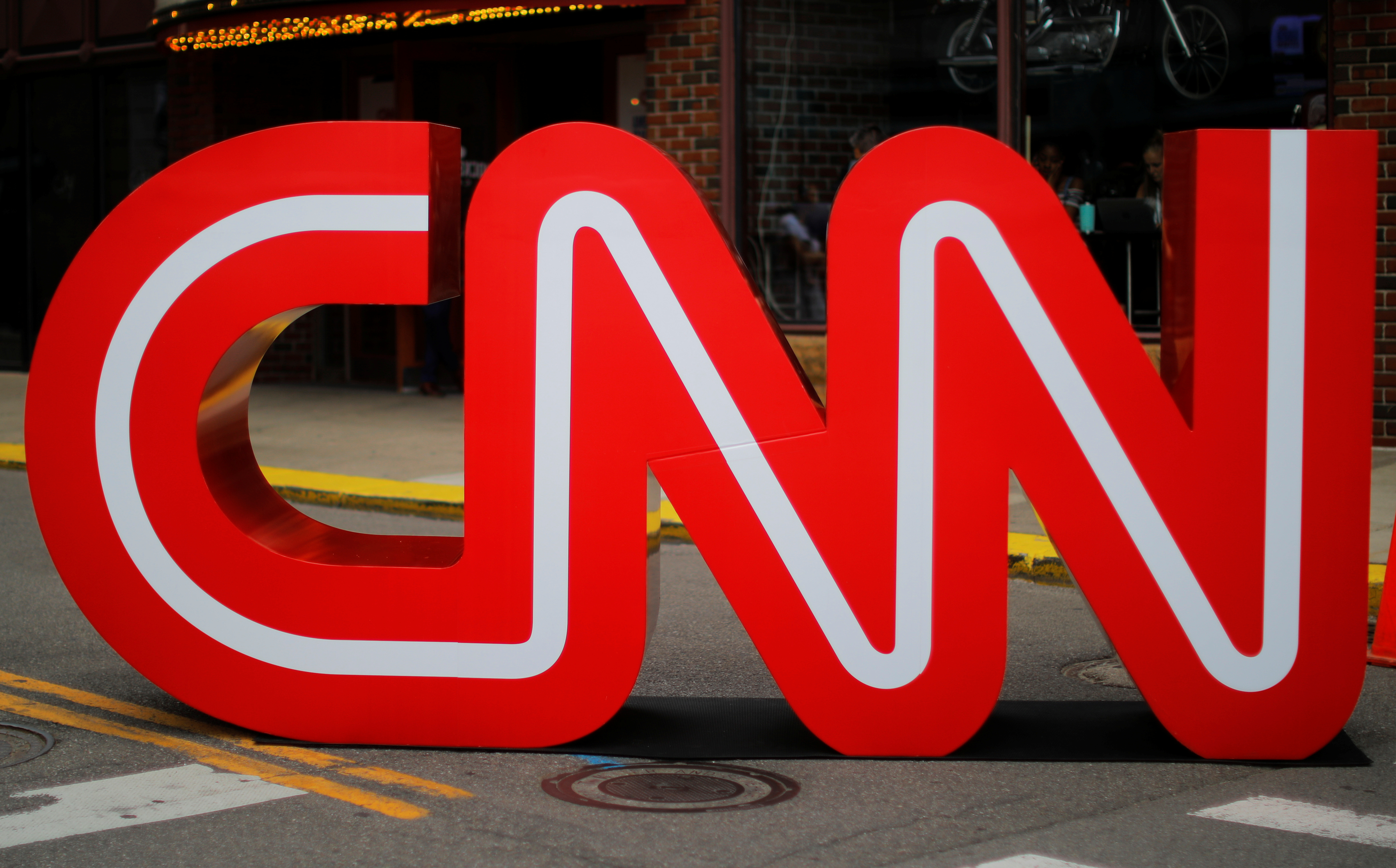 The CNN logo stands outside the venue of the second Democratic 2020 U.S. presidential candidates debate, in the Fox Theater in Detroit, Michigan, U.S., July 30, 2019.    REUTERS/Brian Snyder/File Photo