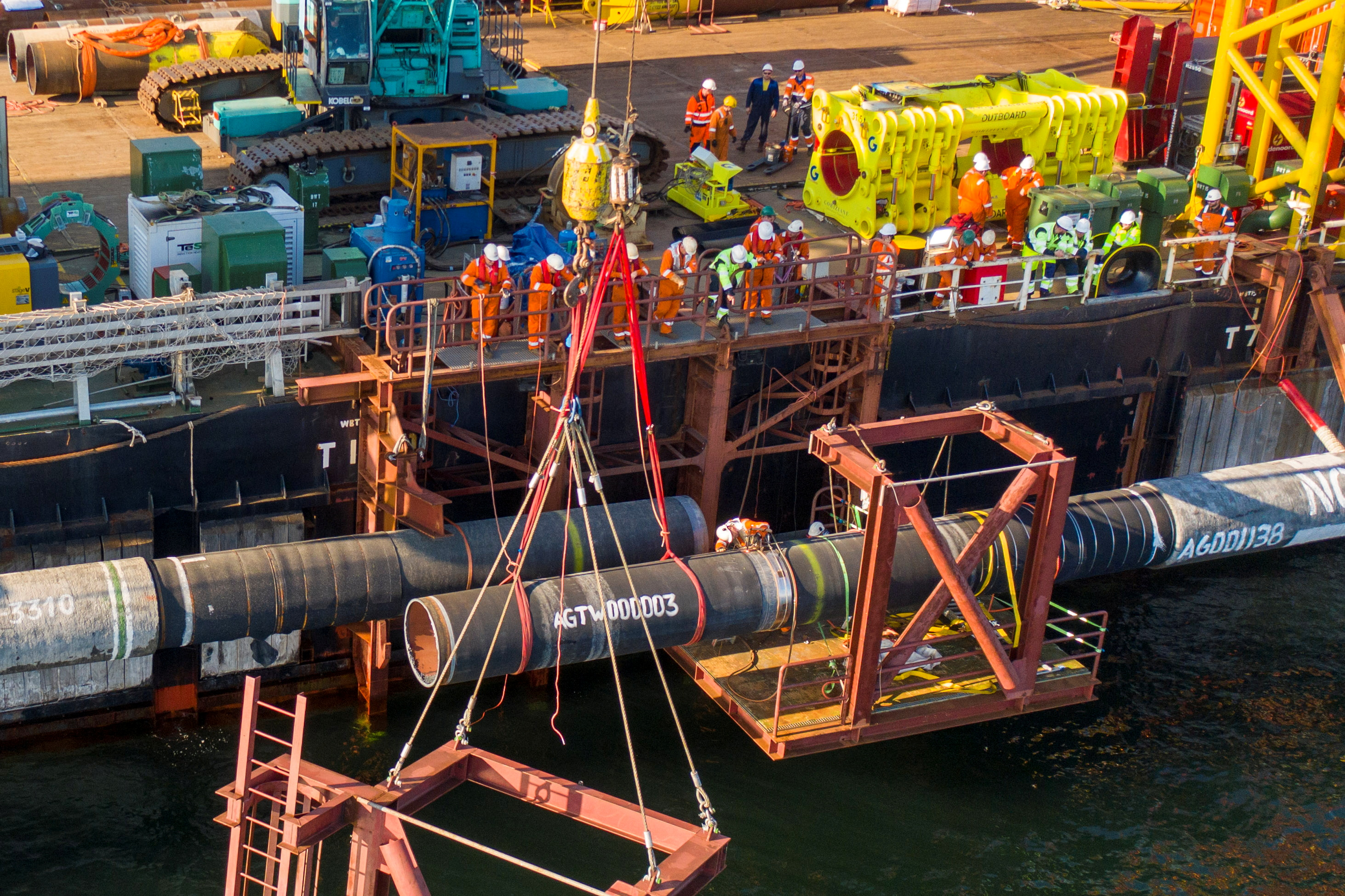 Specialists perform an above-water tie-in while finishing the construction of the Nord Stream 2 gas subsea pipeline onboard the laybarge Fortuna in the Baltic Sea, September 8, 2021. Picture taken September 8, 2021. Nord Stream 2/Handout via REUTERS