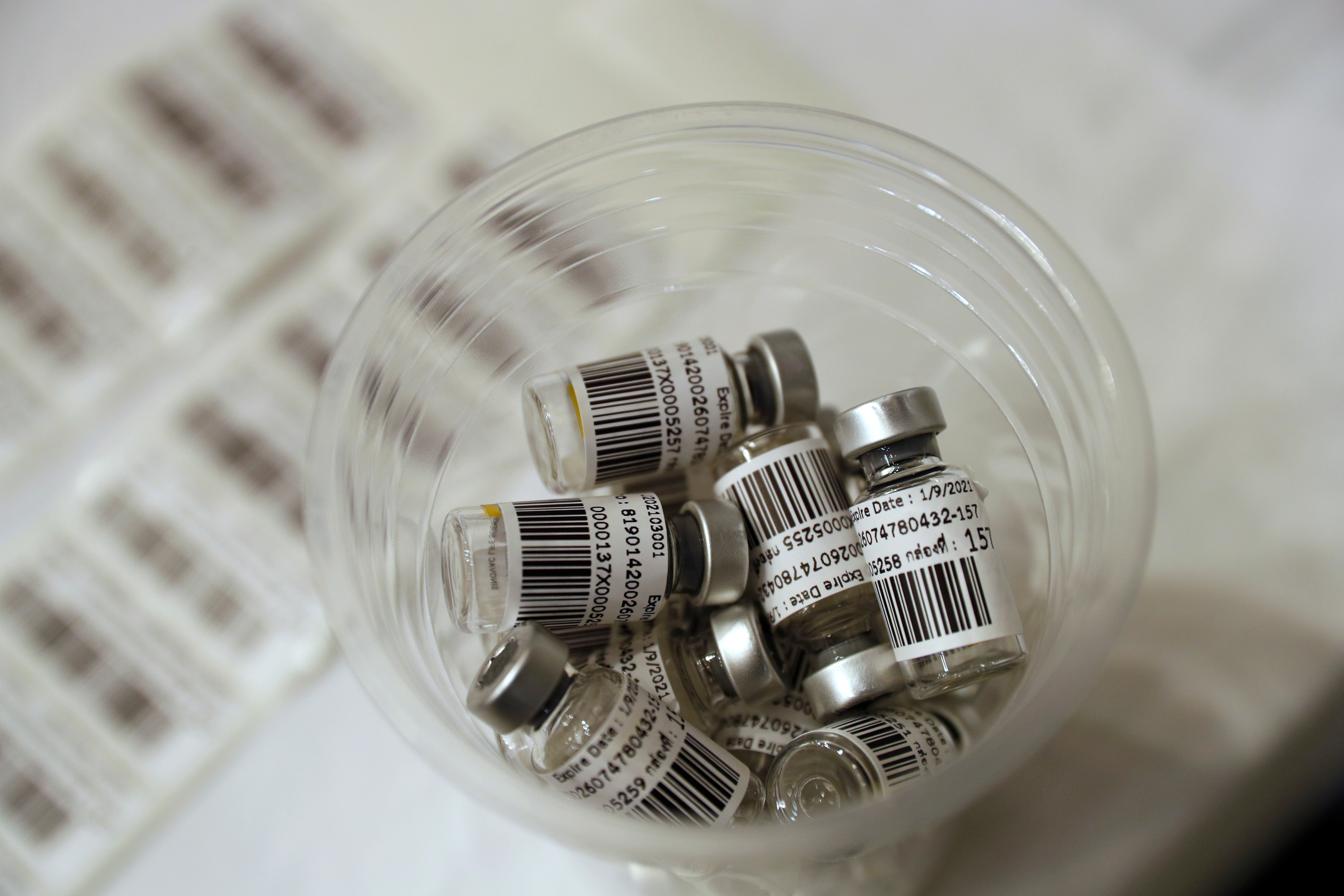 Dispensed vials of the Sinovac COVID-19 vaccine are seen as the Thai resort island of Phuket rushes to vaccinate its population amid the coronavirus disease (COVID-19) outbreak, and ahead of a July 1 ending of strict quarantine for overseas visitors, to bring back tourism revenue in Phuket, Thailand, April 1, 2021. REUTERS/Jorge Silva